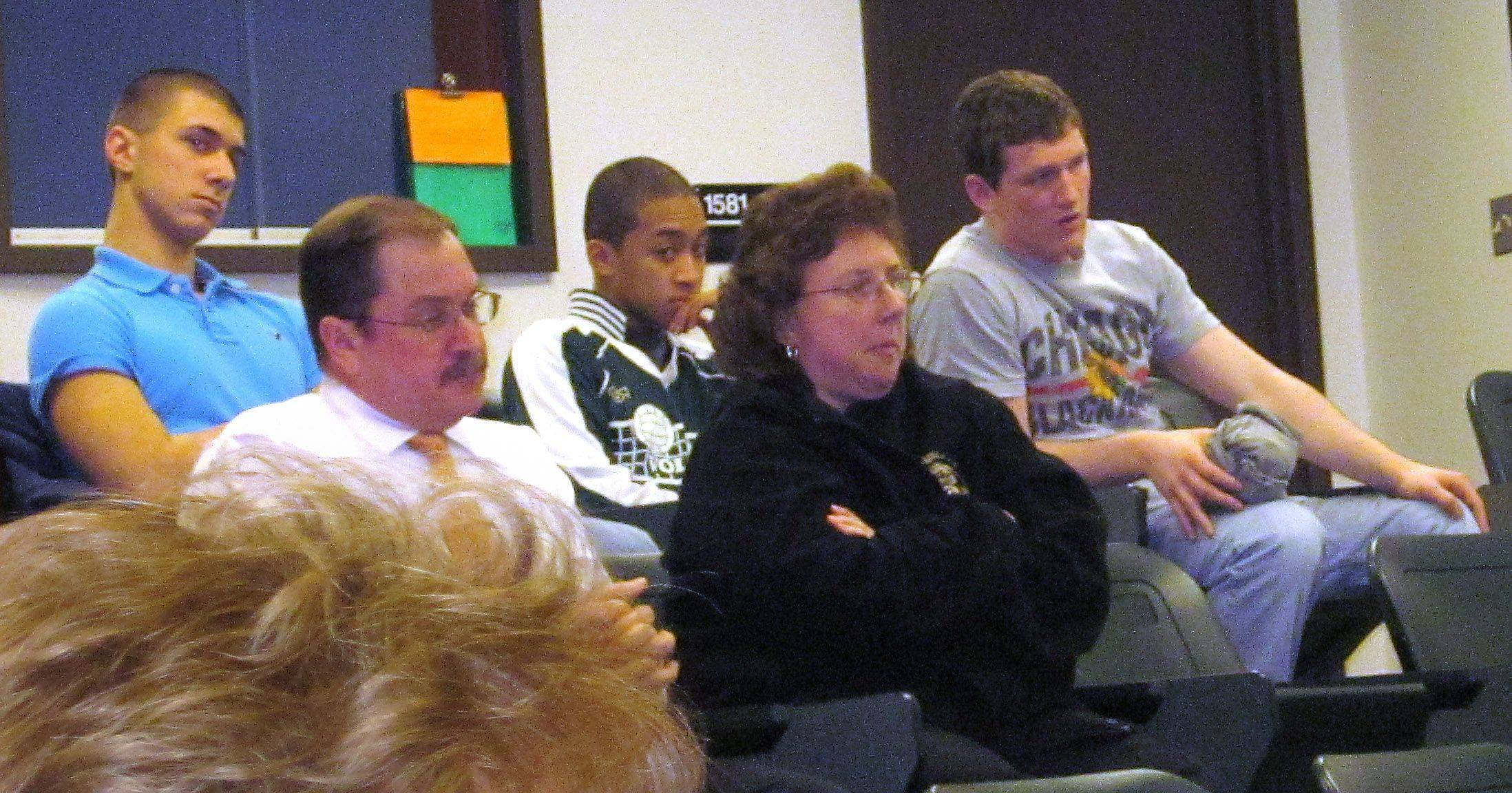Richard Downes, front left, and his wife Debbie Downes, were among roughly 25 spectators who received no information after Grayslake High School District 127 board members voted on personnel matters March 10. The couple was concerned about action against some wrestling coaches.