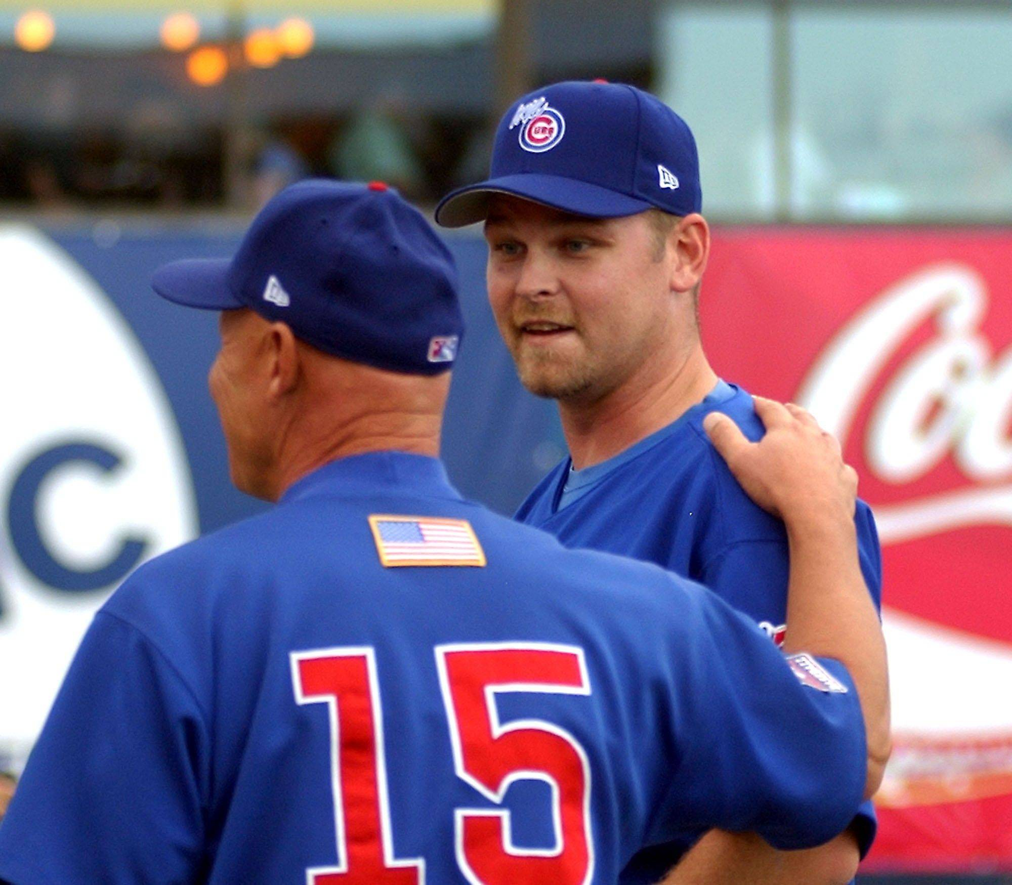 Chicago Cubs pitcher Kerry Wood talks with Iowa Cubs manager Mike Quade before a rehab outing against the New Orleans Zephyrs Monday.