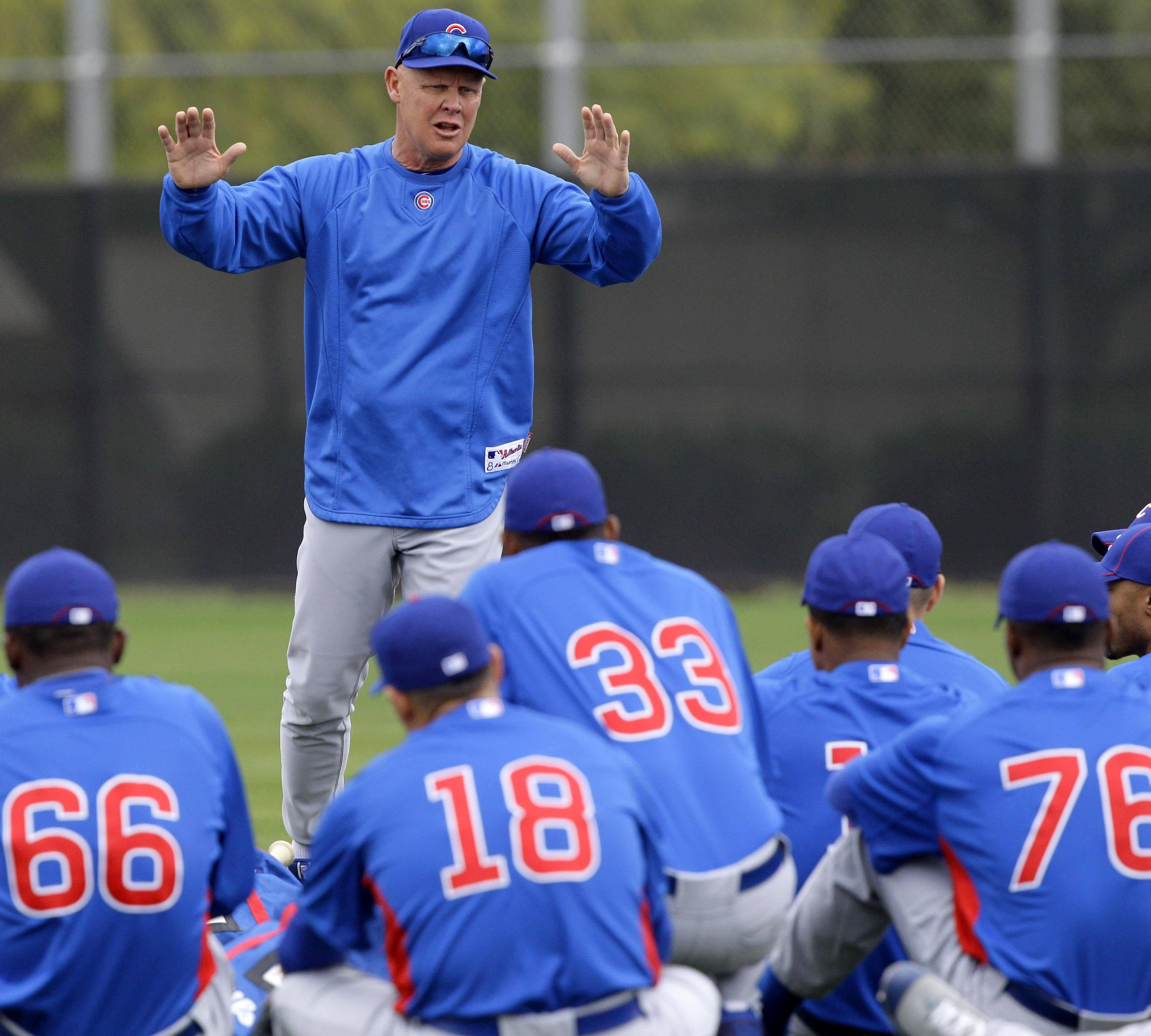 Cubs manager Mike Quade, here talking with his team at the start of spring training camp in Mesa, Ariz., looks at his role much like a teacher.