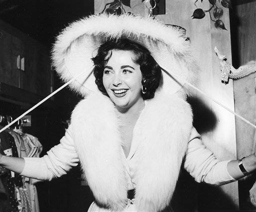 In a March 7, 1956 photo provided by the Las Vegas News Bureau, Elizabeth Taylor shops in Las Vegas.