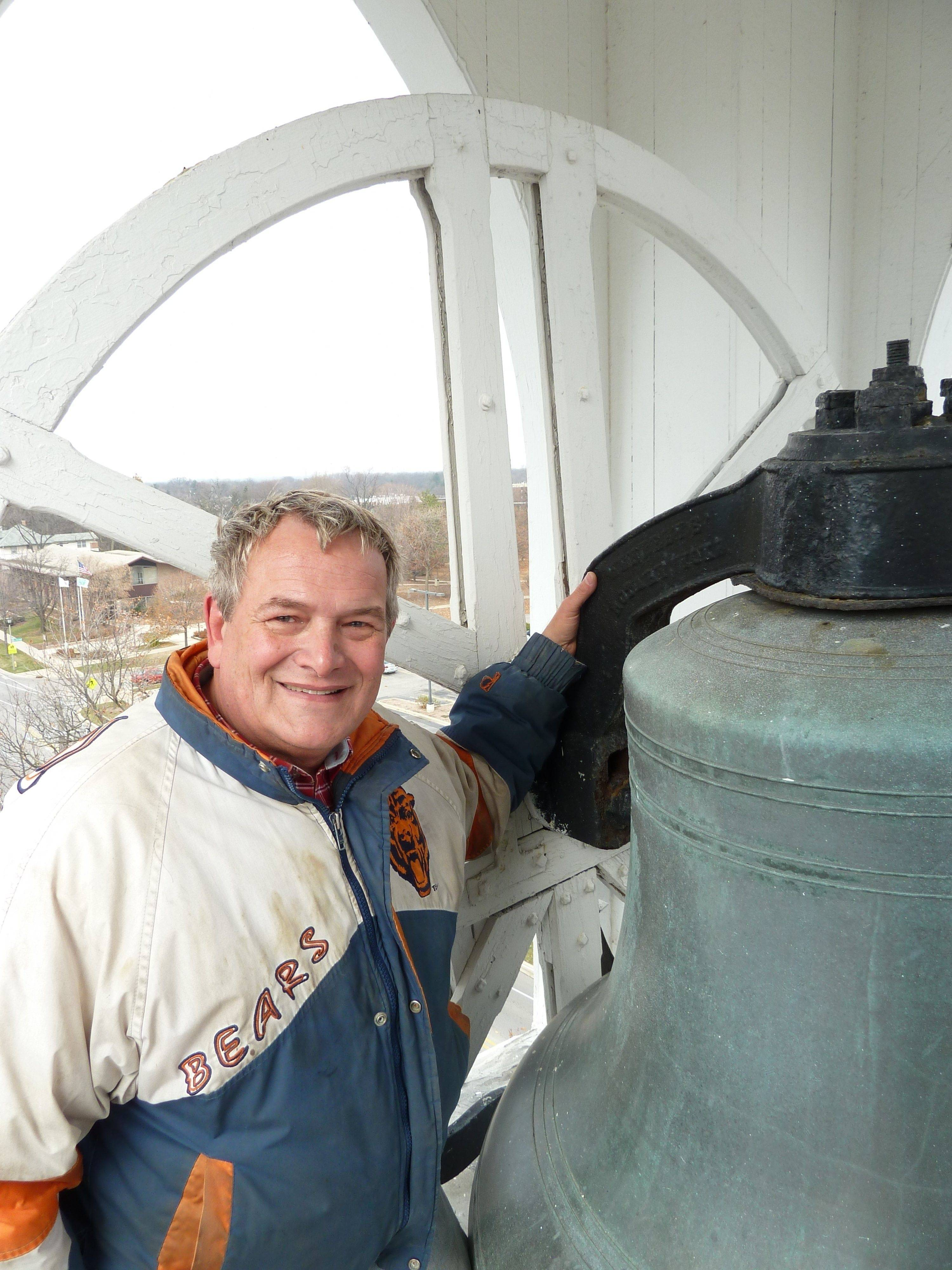 Ken Bohl stands in the bell tower of downtown Lombard's Maple Street Chapel, which is in need of a new roof.