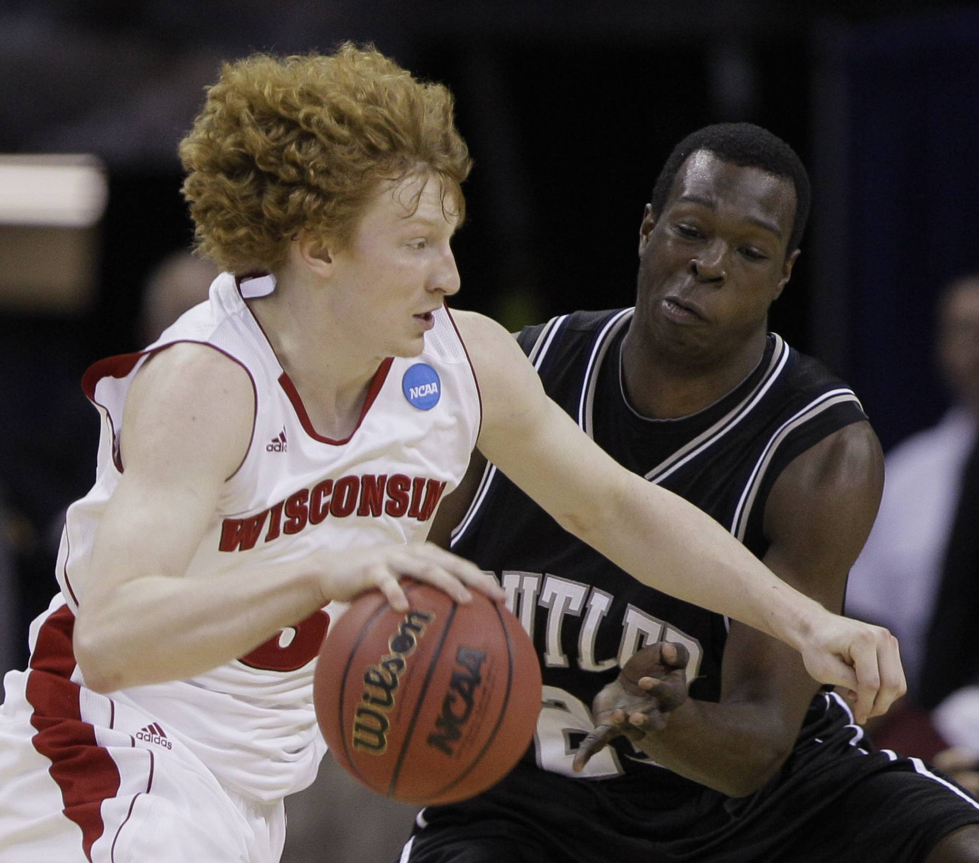 Wisconsin's Mike Bruesewitz tries to drive past Butler's Khyle Marshall during the second half of the NCAA Southeast regional college basketball semifinal game Thursday, March 24, 2011, in New Orleans.