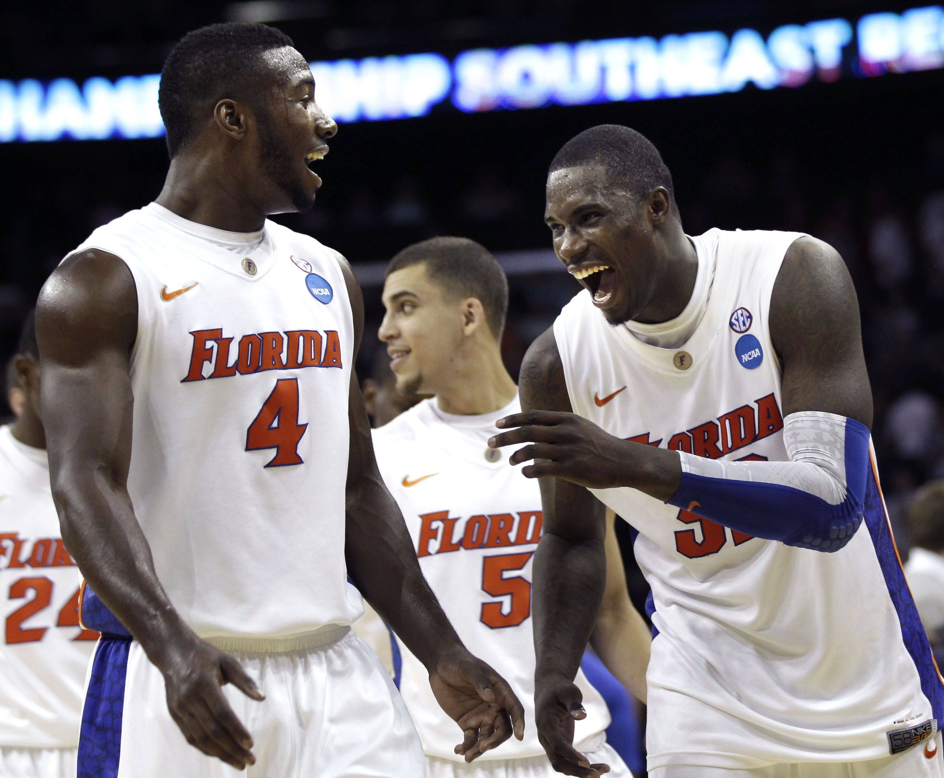 Florida's Patric Young, left, and Vernon Macklin celebrate Thursday night's victory over BYU.