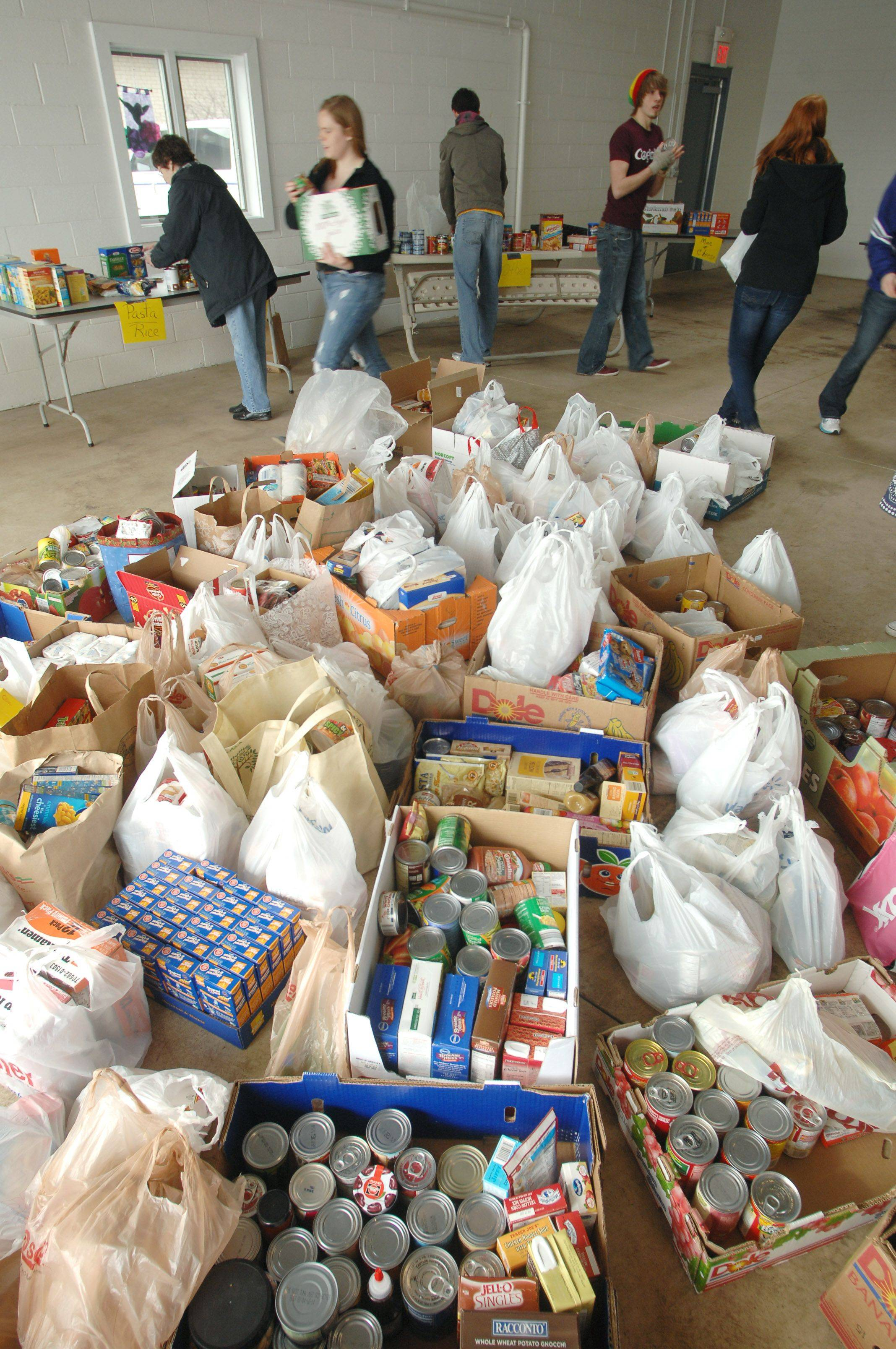 Wauconda High School students organize the food delivery at the Wauconda-Island Lake Food Pantry Friday morning. Students collected more than 2,100 items as part of their annual food drive this year.
