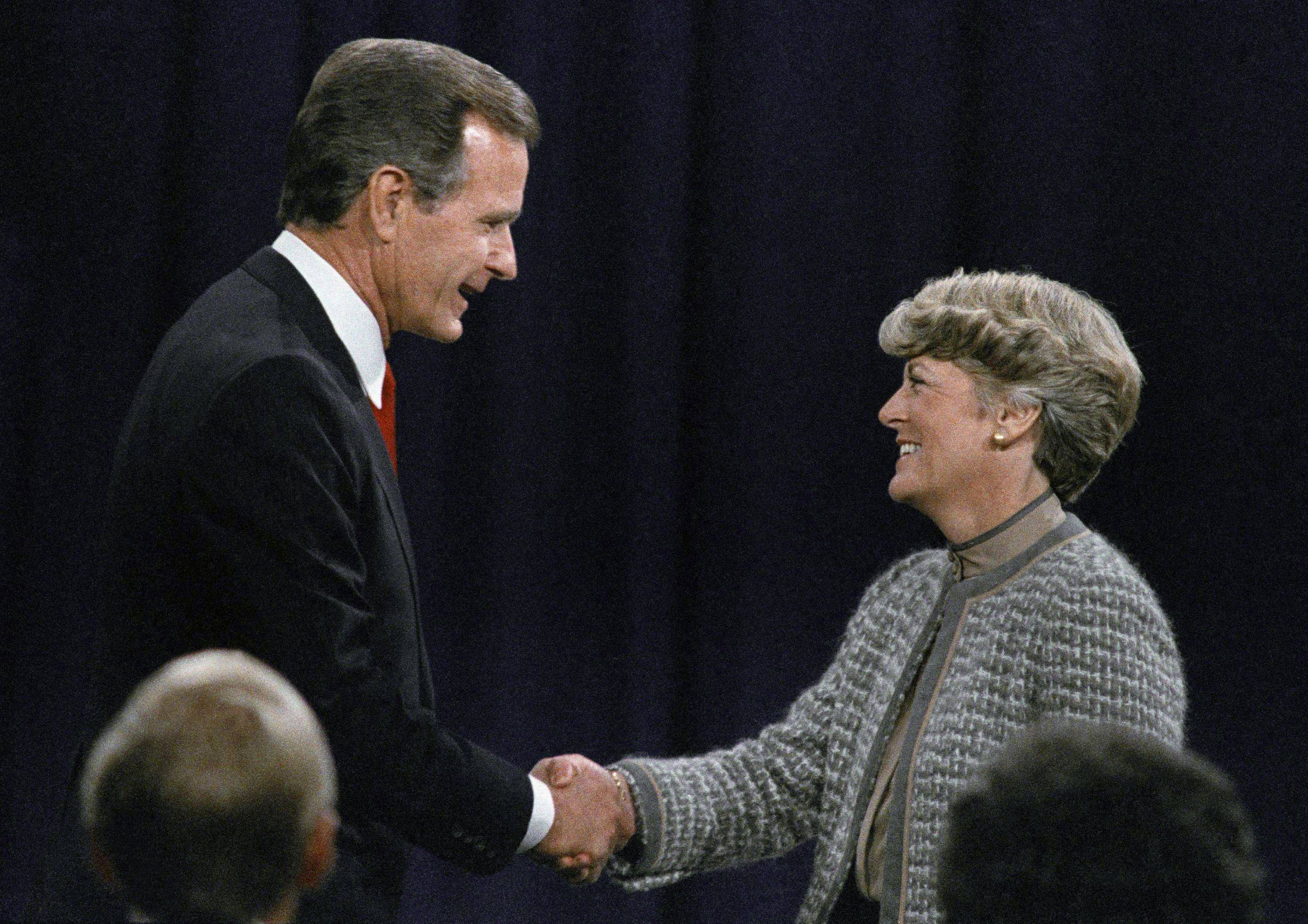 In this Thursday, Oct. 11, 1984 file picture, Vice-President George H. Bush, left, shakes hands with Democratic vice-presidential candidate Geraldine Ferraro before the beginning of their debate in Philadelphia.