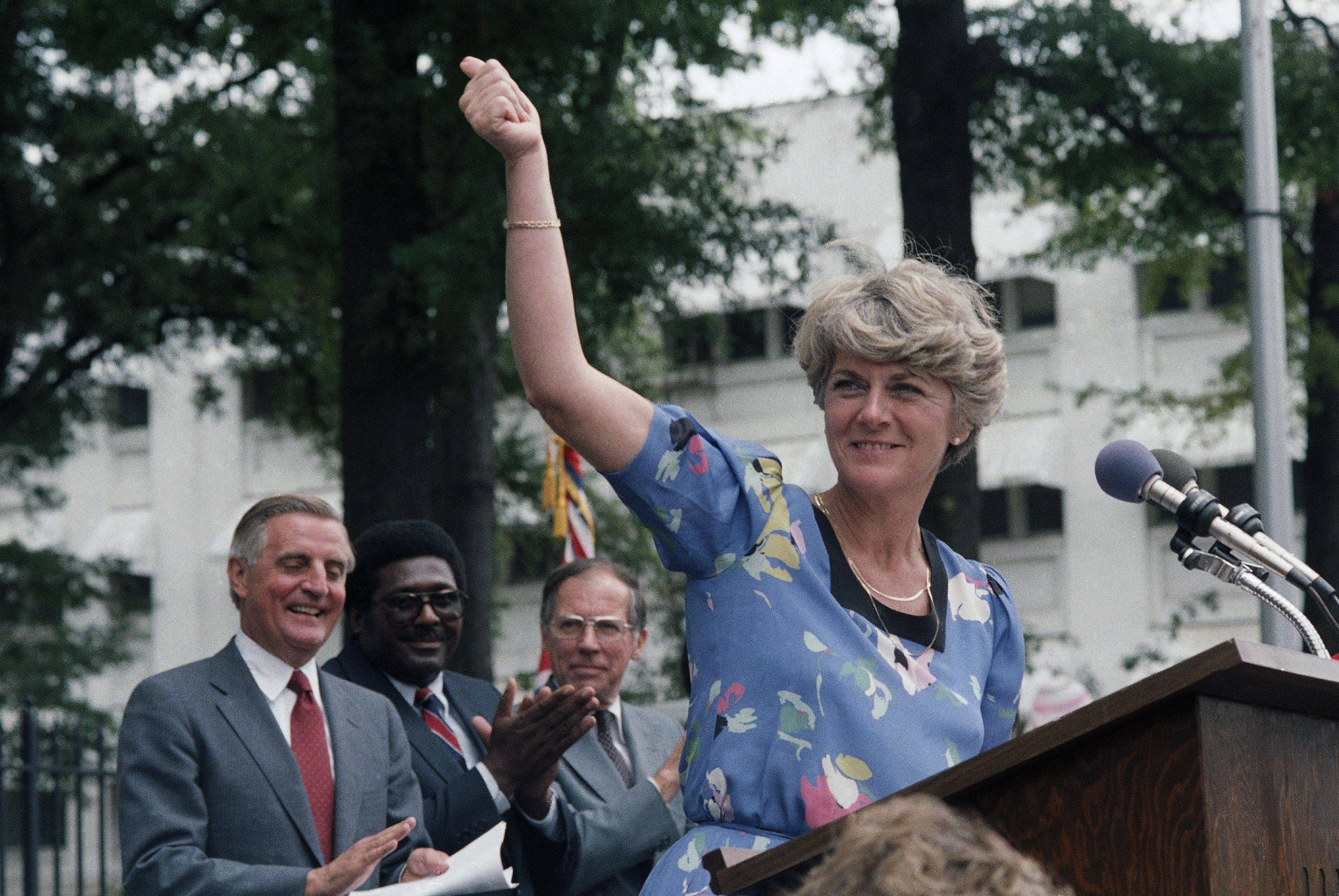In this Wednesday, Aug. 1, 1984 file picture, Democratic Vice Presidential candidate Geraldine Ferraro gives the thumbs-up sign to a crowd of supporters in downtown Jackson, Miss. as Walter Mondale and Ferraro kicked off their 1984 campaign in this Southern city. Behind Ferraro are Mondale, state Rep. Robert Clark and former Gov. William Winter.