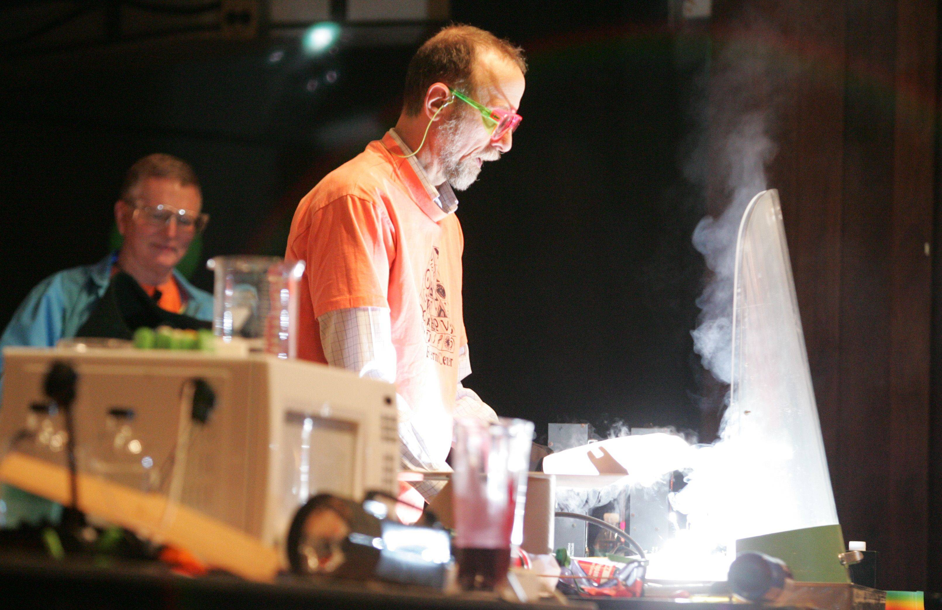 Lee Marek of the University of Illinois at Chicago creates a blinding white light for the crowd as he burns magnesium surrounded by dry ice.