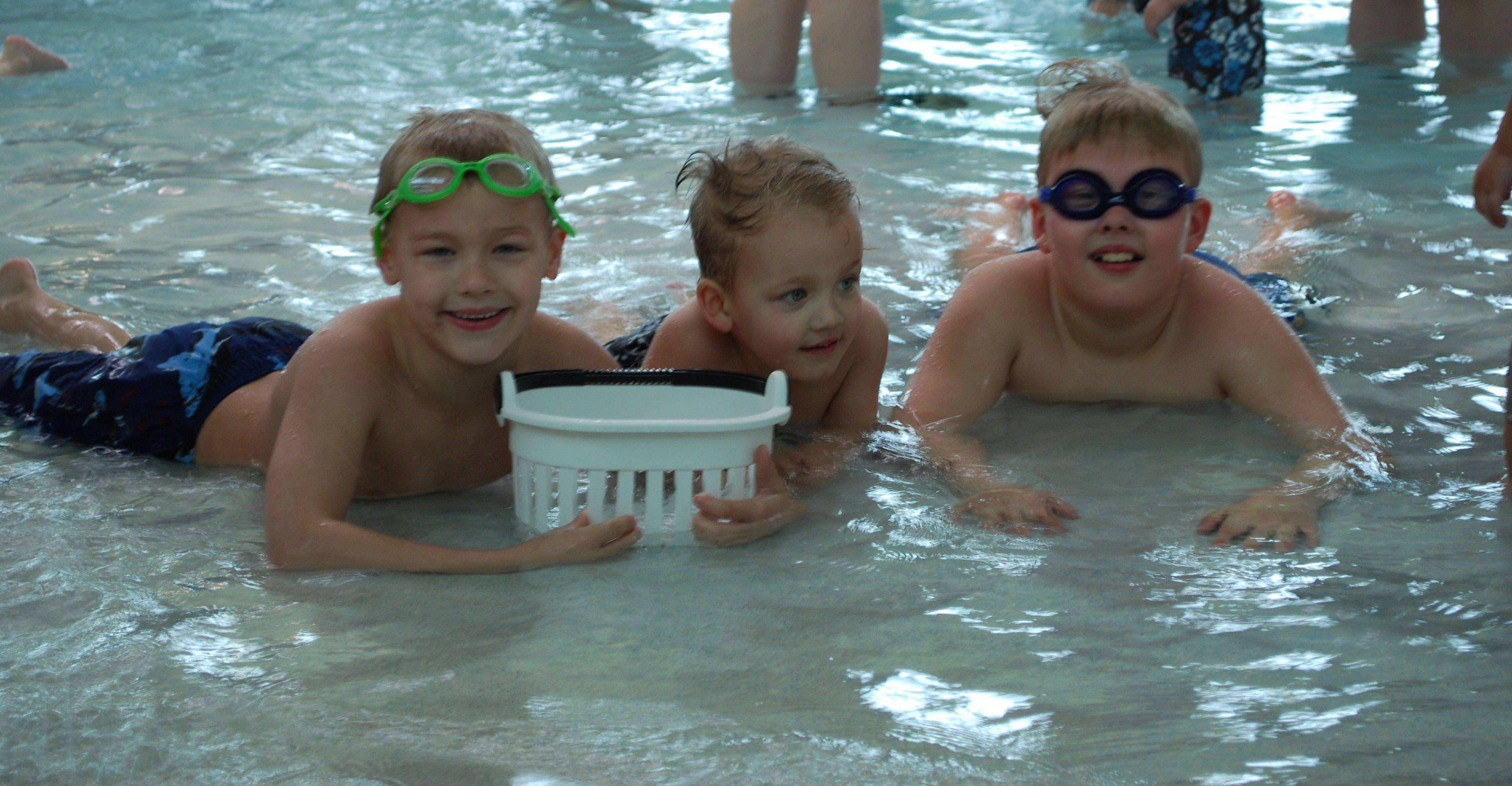 Pictured at a previous Aqua Egg Hunt at Splash Central, from left, are Alex, Adam and Andrew Collier.