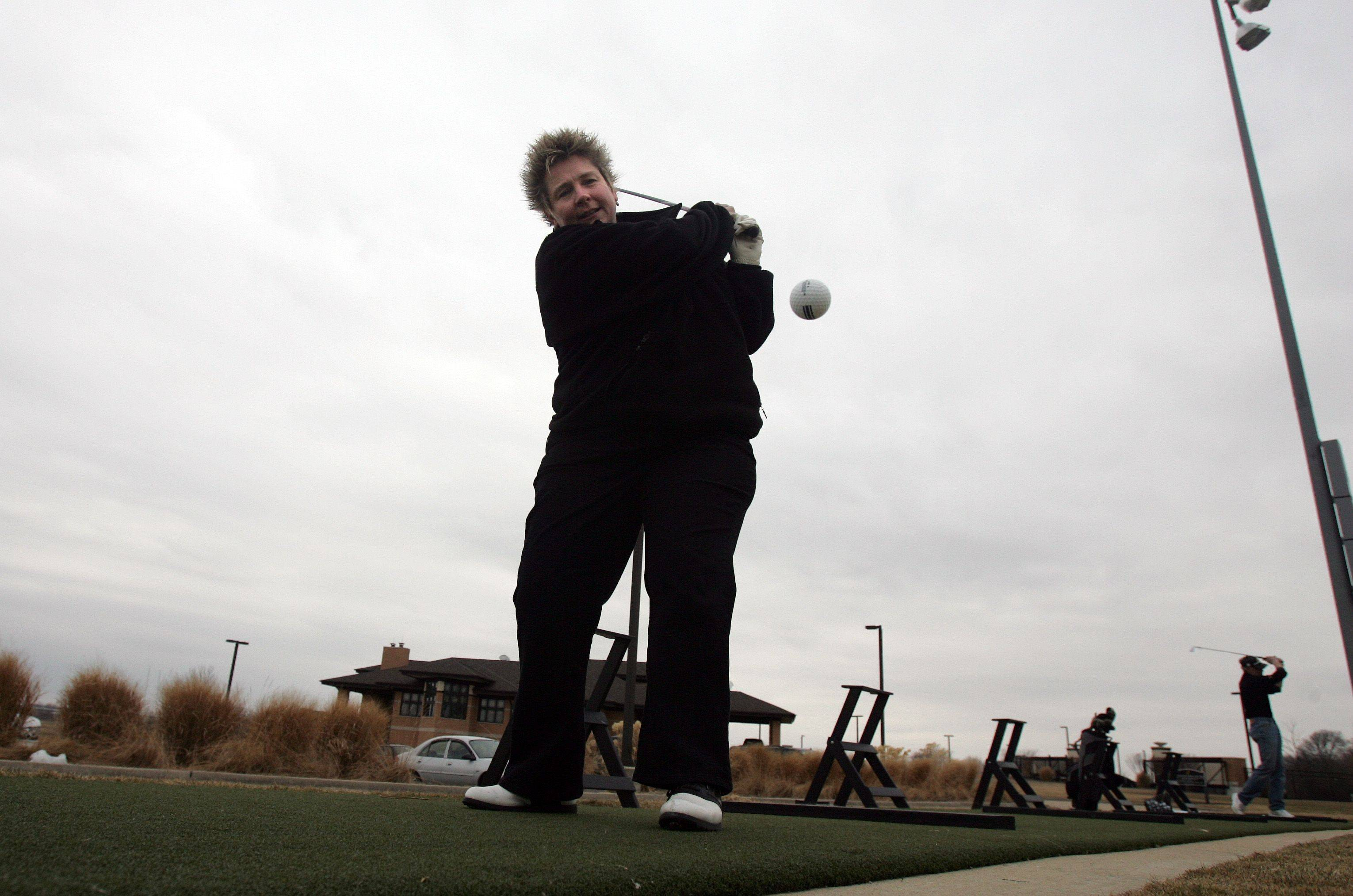 """You have got to get out and enjoy it, even if it is windy."" remarked Dona Stretch, of Elgin as she hit golf balls at the Highlands Golf Course in Elgin Thursday, March 17."