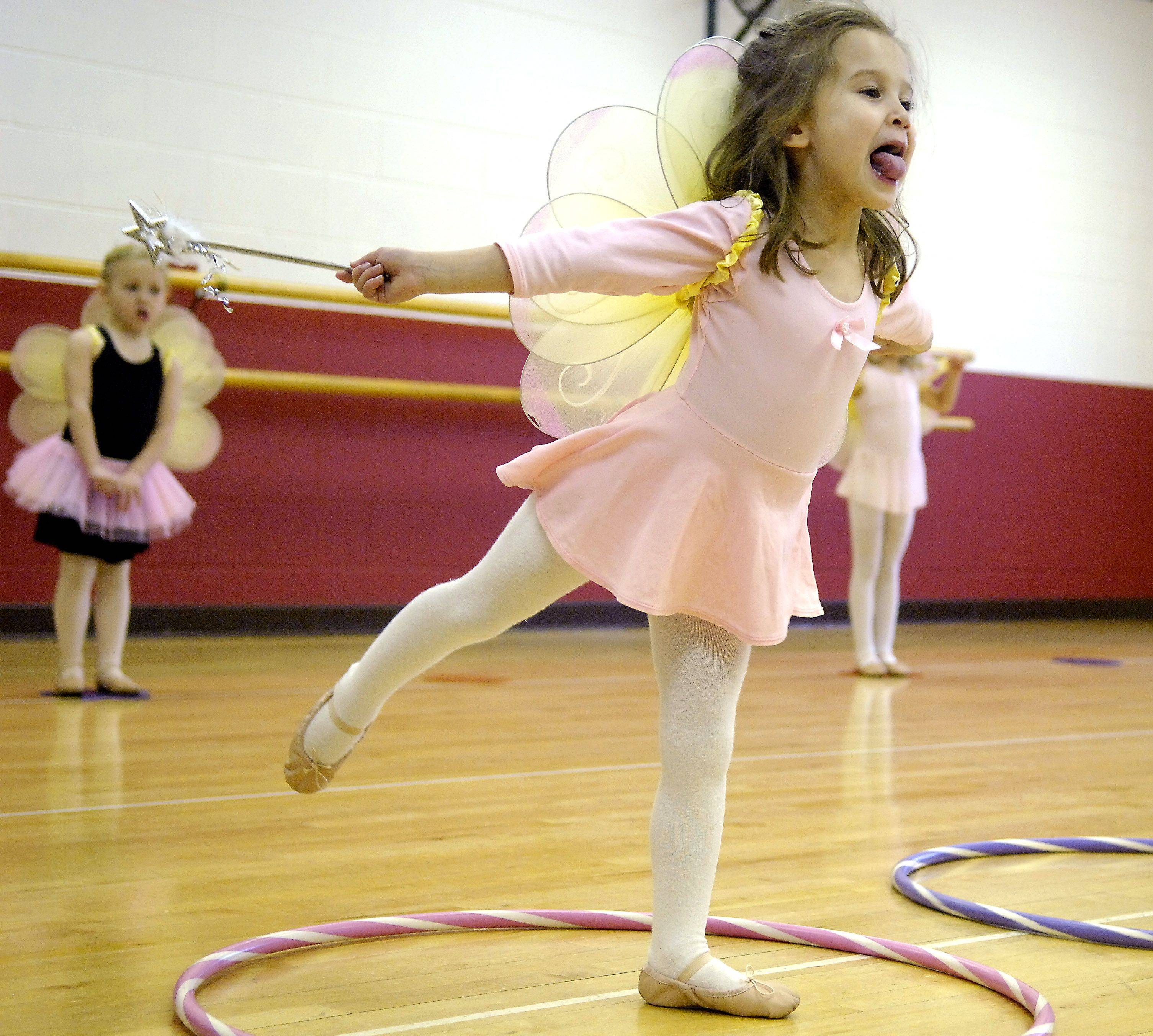 Four-year-old Alexandra Lee of Geneva practices her arabesques during a pre-ballet class at the Sunset Racquetball and Fitness Center in Geneva Wednesday. The tongue sticking out isn't normally part of the position, but she added her own little flourish.