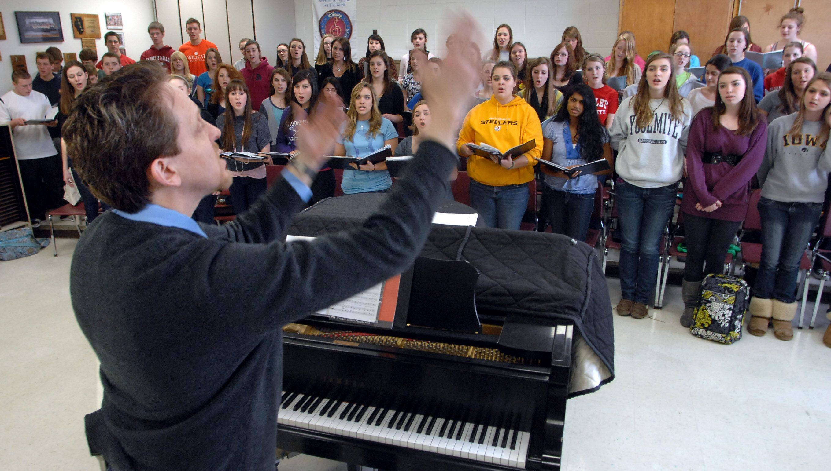 Director of choirs Jeffrey Brown leads the Libertyville High School choir Thursday before heading to Italy. They are scheduled to sing at the Vatican this Sunday.
