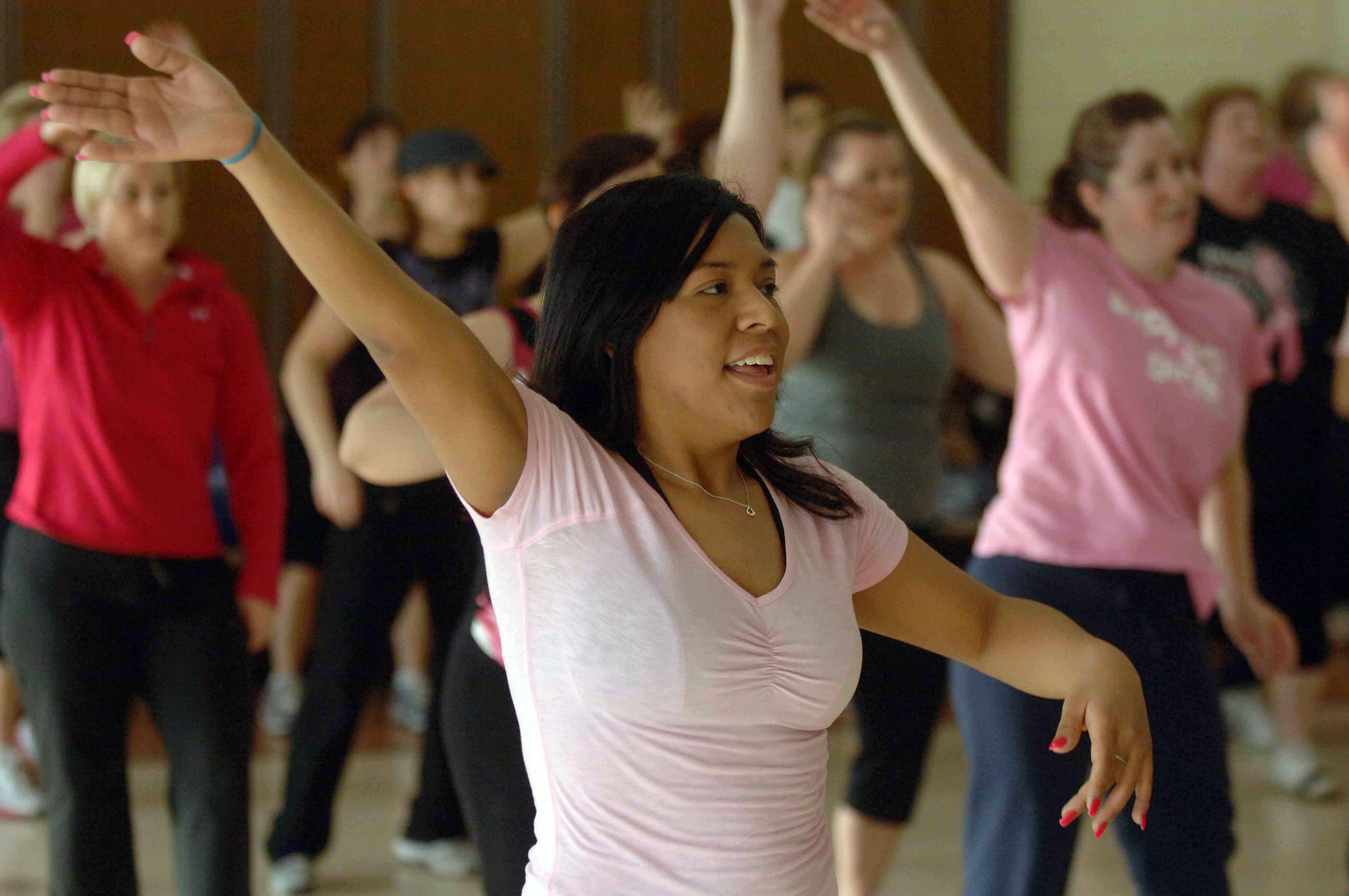 Stephanie Vazquez of Villa Park takes part in the Zumbathon to benefit the Susan G. Komen Cure to Fight Breast Cancer Saturday, held at the Iowa Community Center in Villa Park.