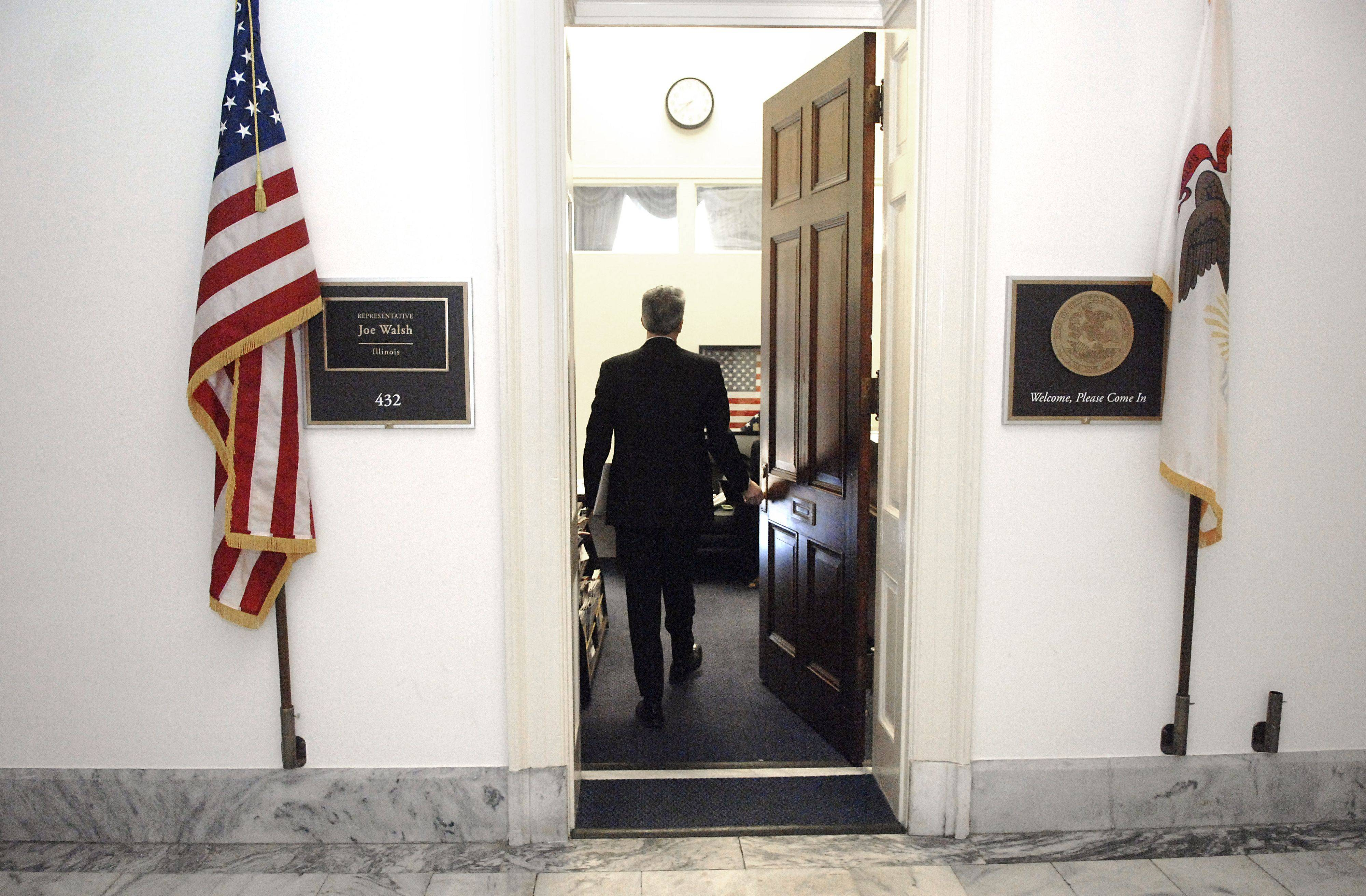 8th District Rep. Joe Walsh returns to his Cannon House office after an early morning GOP breakfast meeting in Washington D.C.