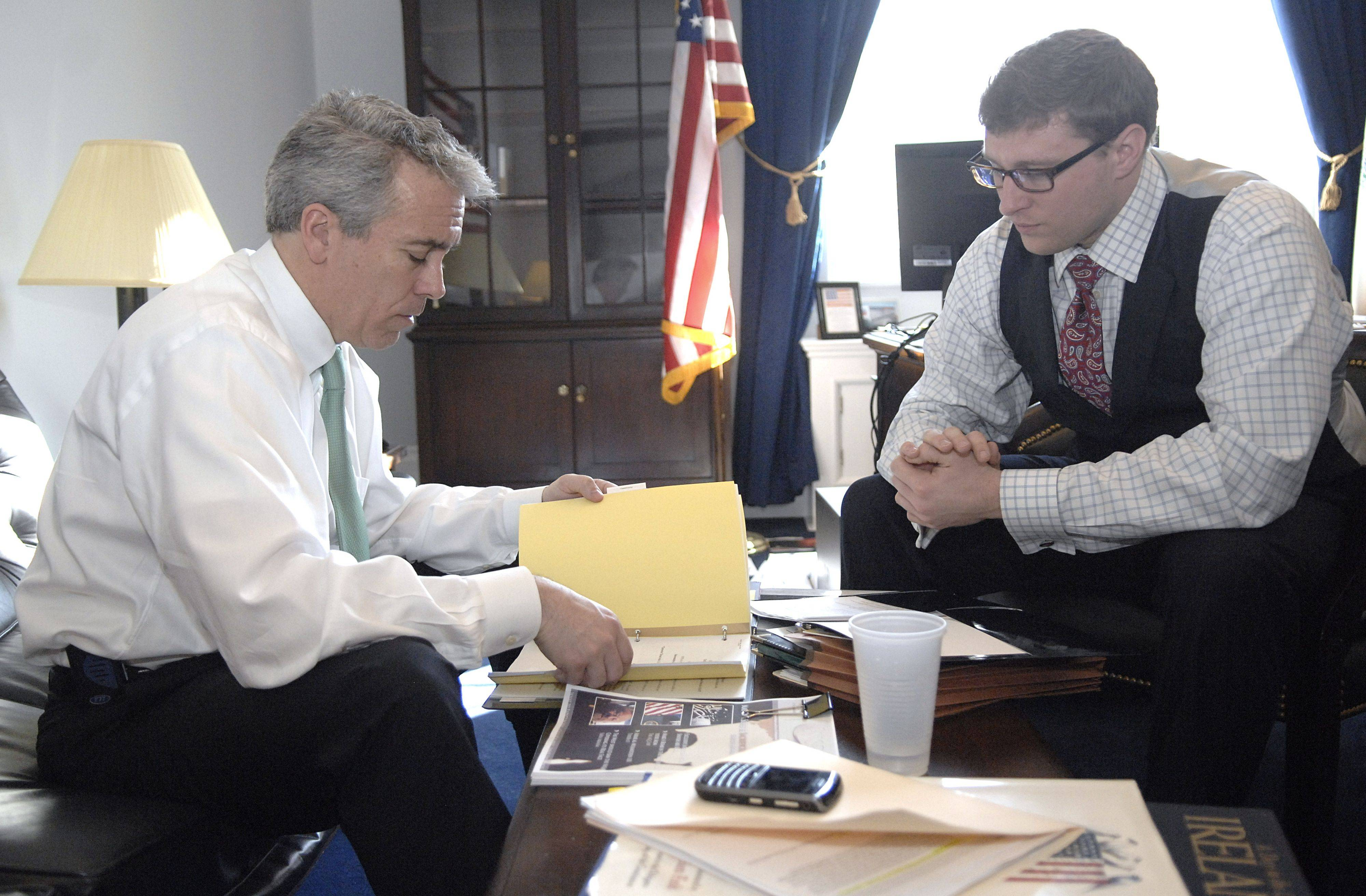 Illinois Congressman Joe Walsh meets with Senior Legislative Assistant Zach Stone before attending a meeting with the Committee on Homeland Security on Wednesday, March 2 in Washington D.C.