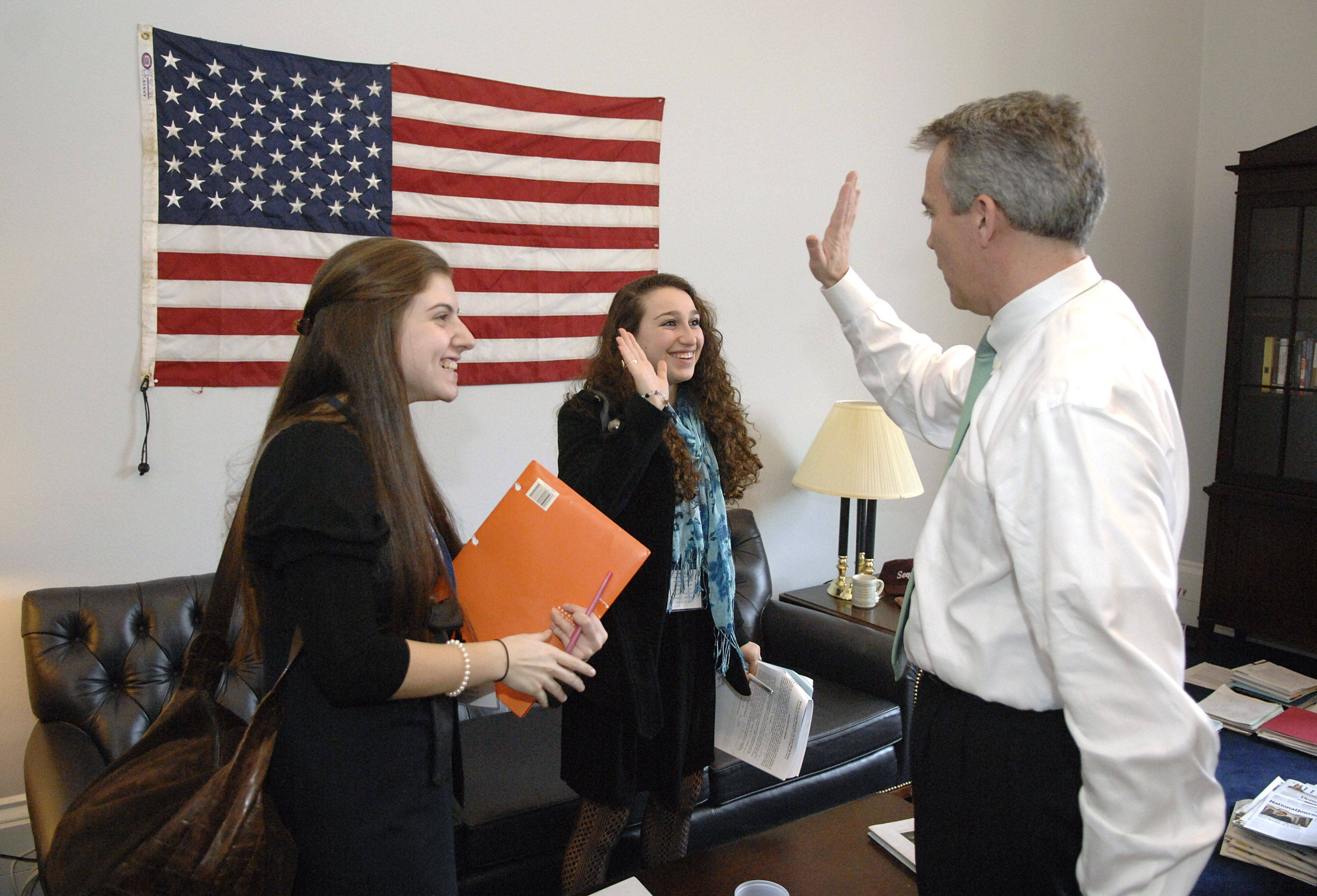 "8th District Rep. Joe Walsh, of McHenry, high fives high school student LeeTal Gabel, Aliza Jaffe, left, and two others involved with the Write On for Israel program connected to the Jewish United Fun/Jewish Federation of Metropolitan Chicago. Walsh asked the students how he compared to the other Congressmen they'd visited that day in Washington, D.C. ""Oh, you're definitely the coolest,"" Gabel told him. Walsh beamed."