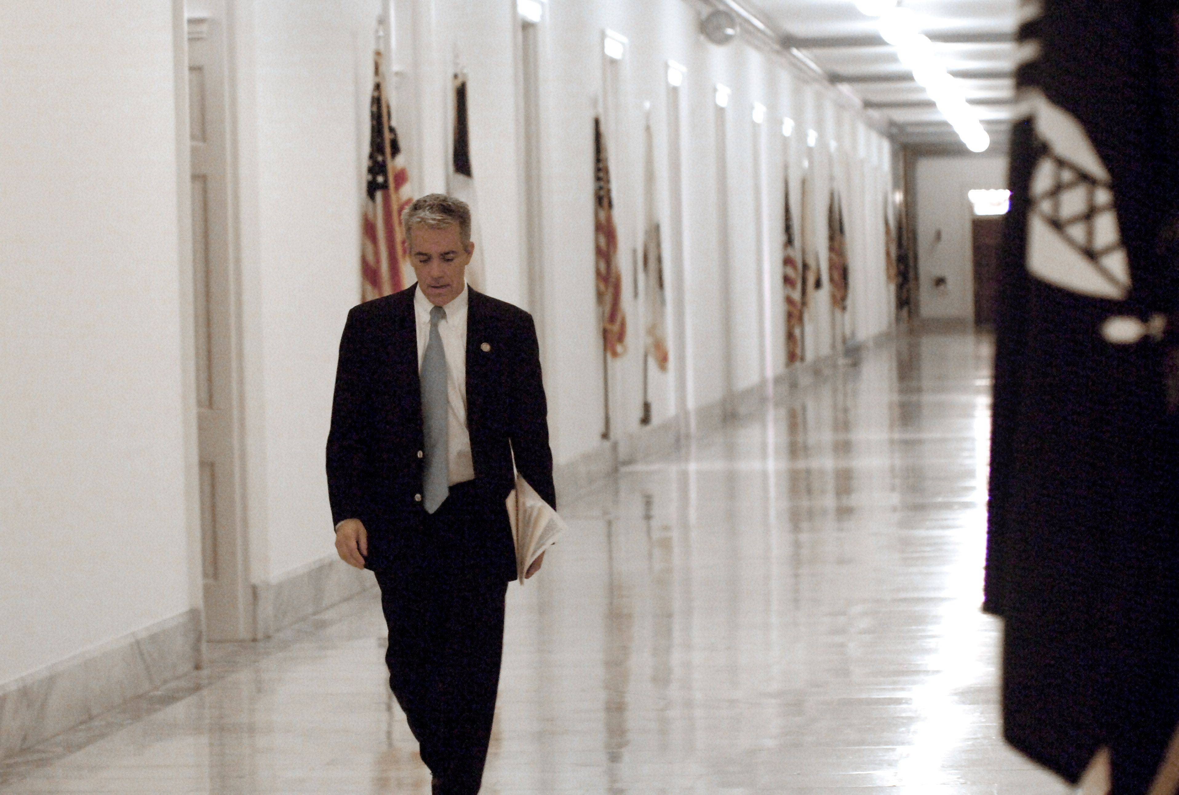 8th District Congressman Joe Walsh walks to his Cannon House office after a GOP breakfast meeting.