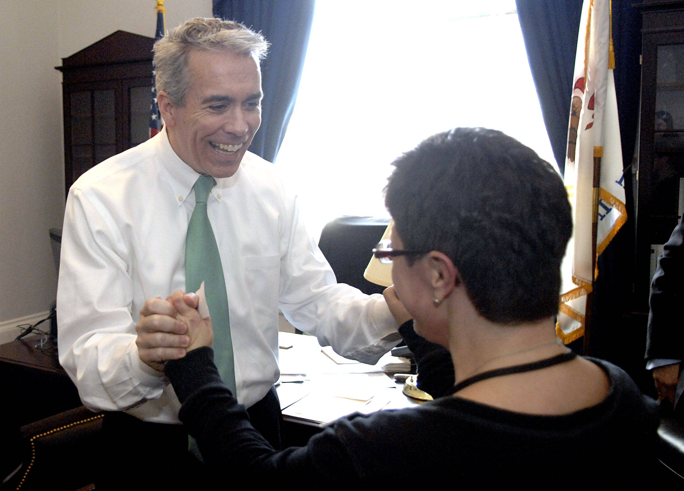 U.S. Rep. Joe Walsh greets Rachel Lipke of Northbrook in his Washington, D.C., office.