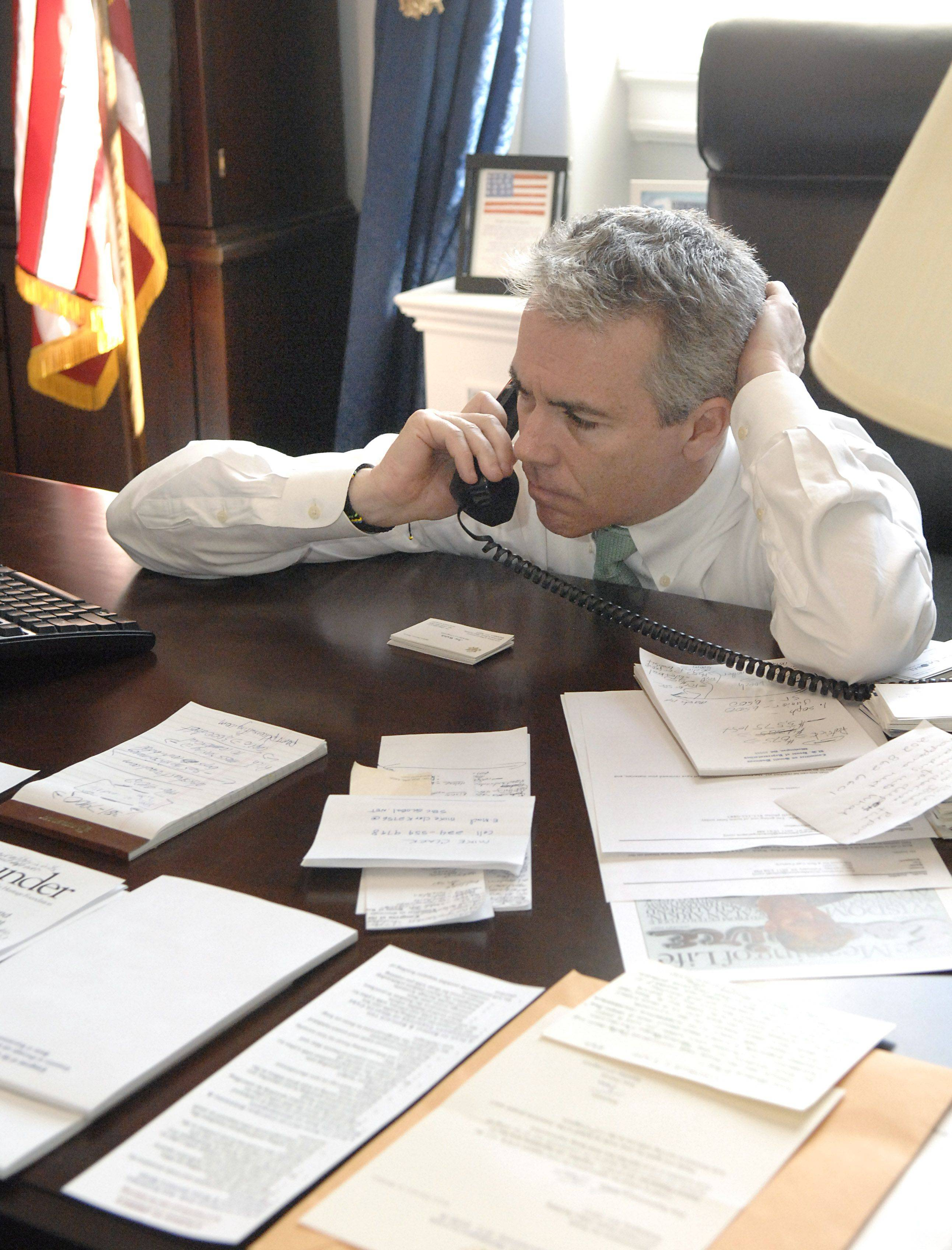 Congressman Joe Walsh takes a phone call in-between meetings in office in the Cannon House Office Building in Washington, D.C.