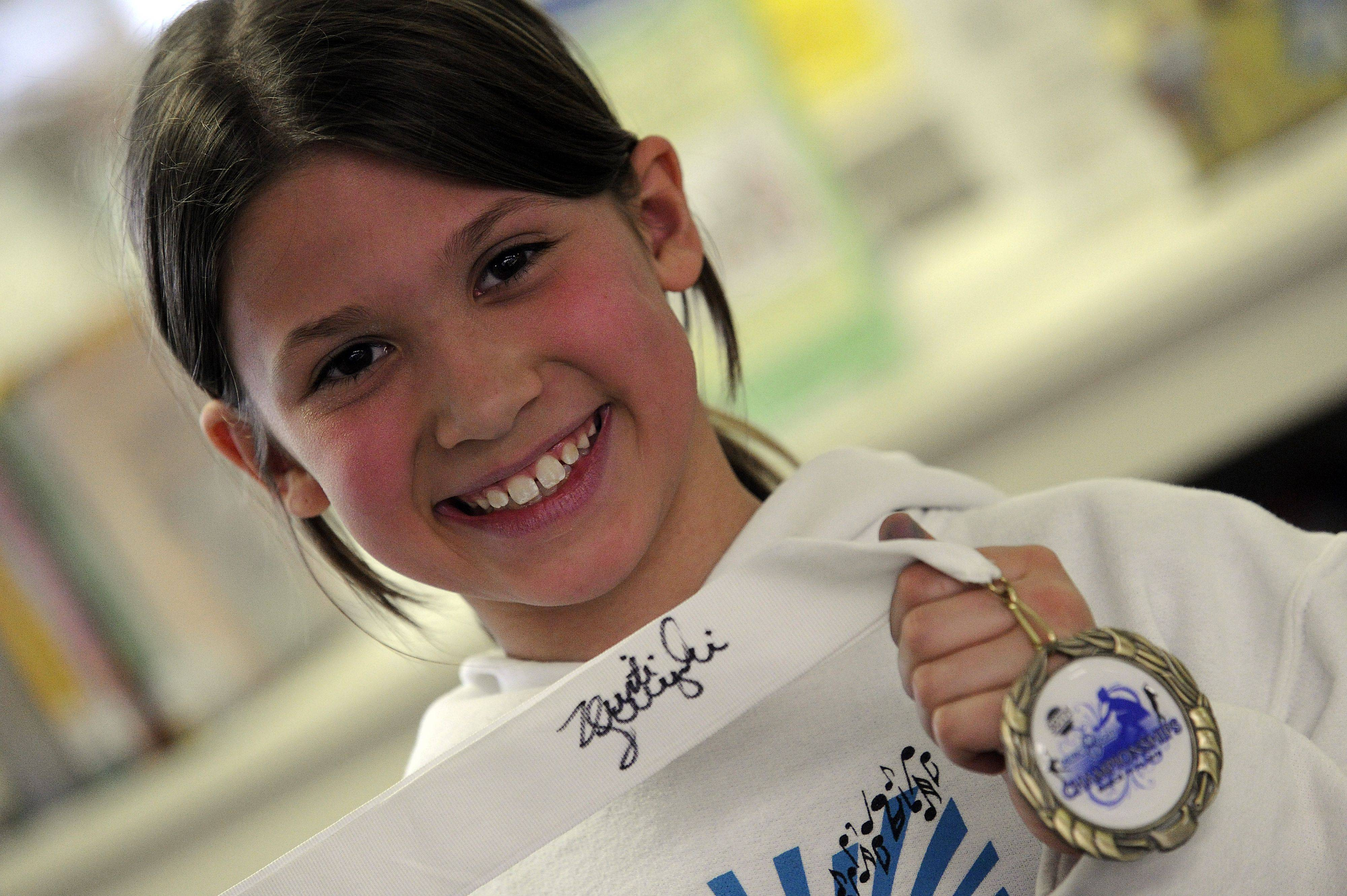 A figure skater herself, Lorelei Stailey, 9, of Arlington Heights had her medal signed by Kristi Yamaguchi.