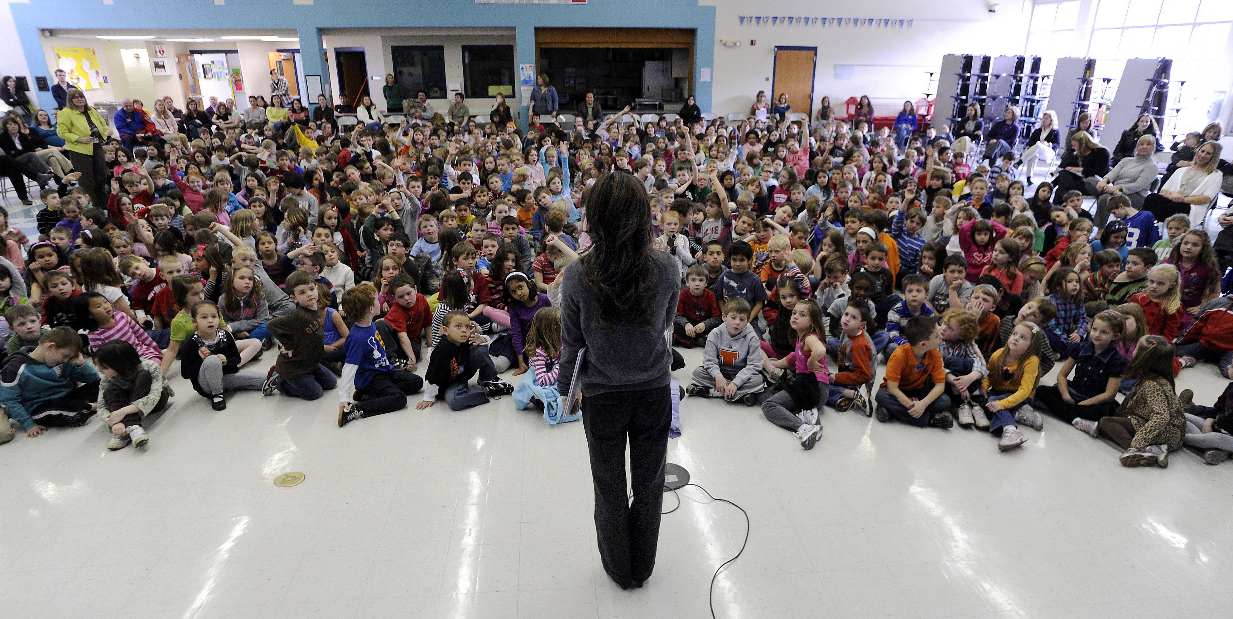Olive-Mary Stitt students ask questions after Yamaguchi read her new children's book.