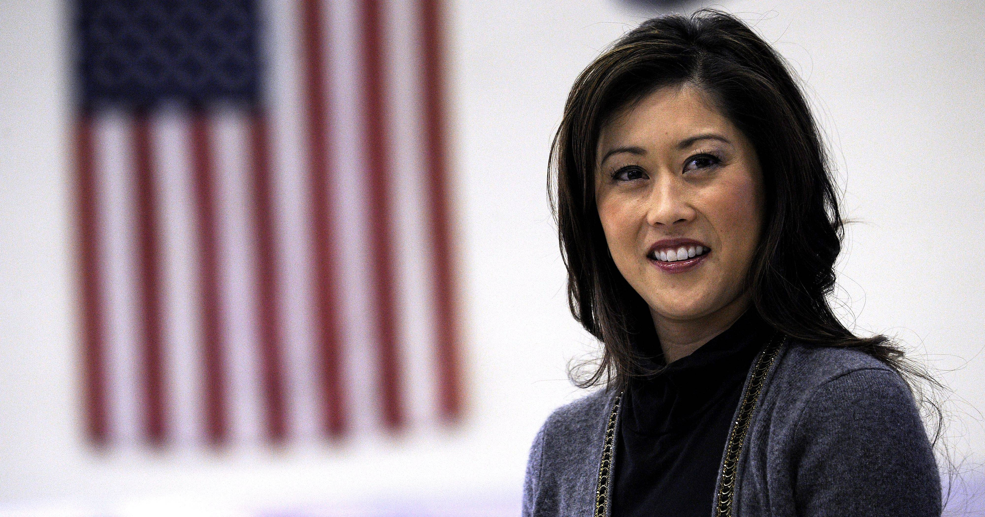 Kristi Yamaguchi answers questions at Olive-Mary Stitt school.