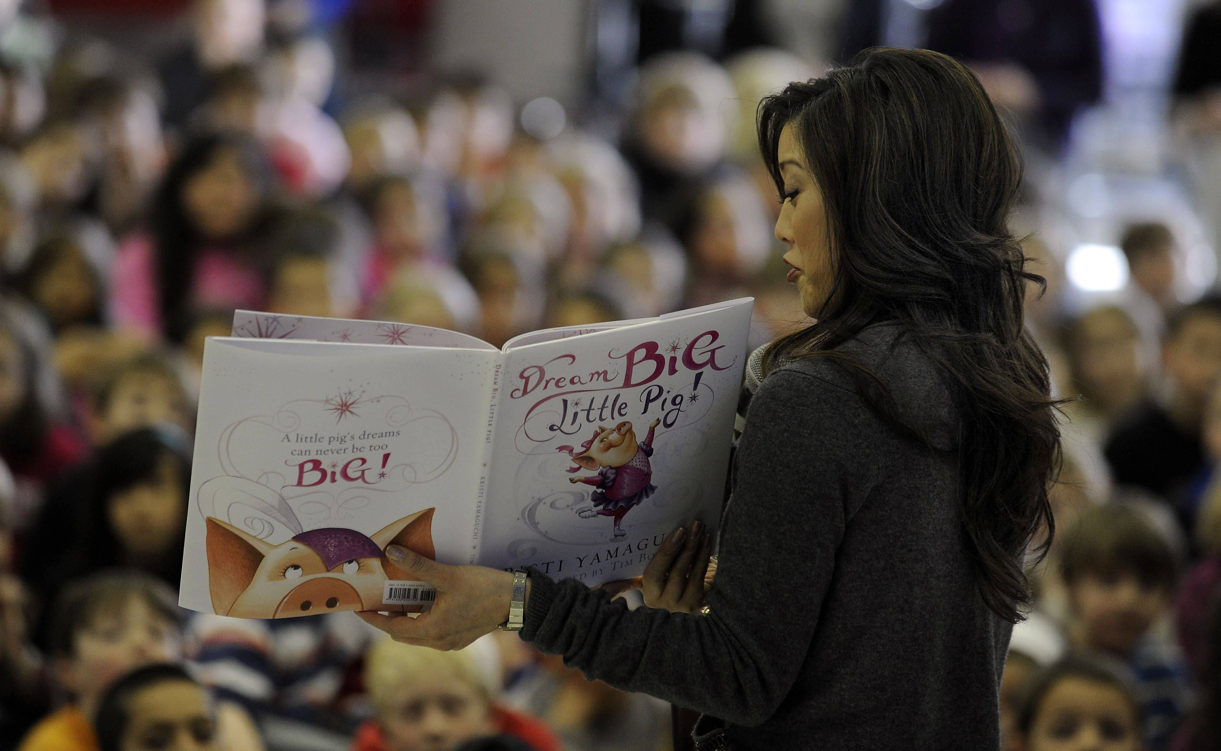 Kristi Yamaguchi reads her new children's book to the school on Tuesday.