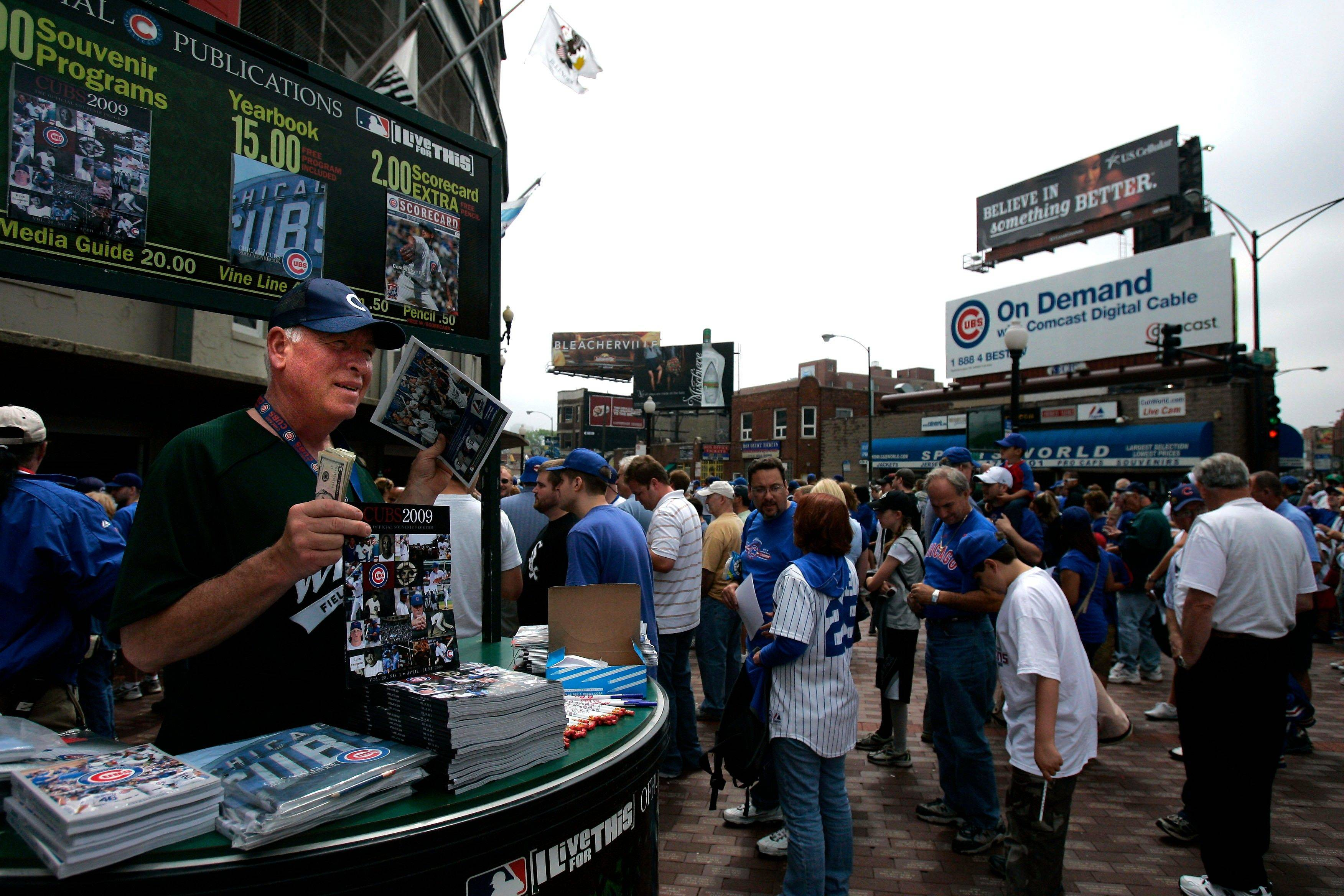 Dave Klemp sells programs before the start of the game between the Cubs and White Sox on June 17, 2009, at Wrigley Field. Add programs, baseball caps, food and drinks, and parking to the ticket costs, and you're laying out some serious cash.