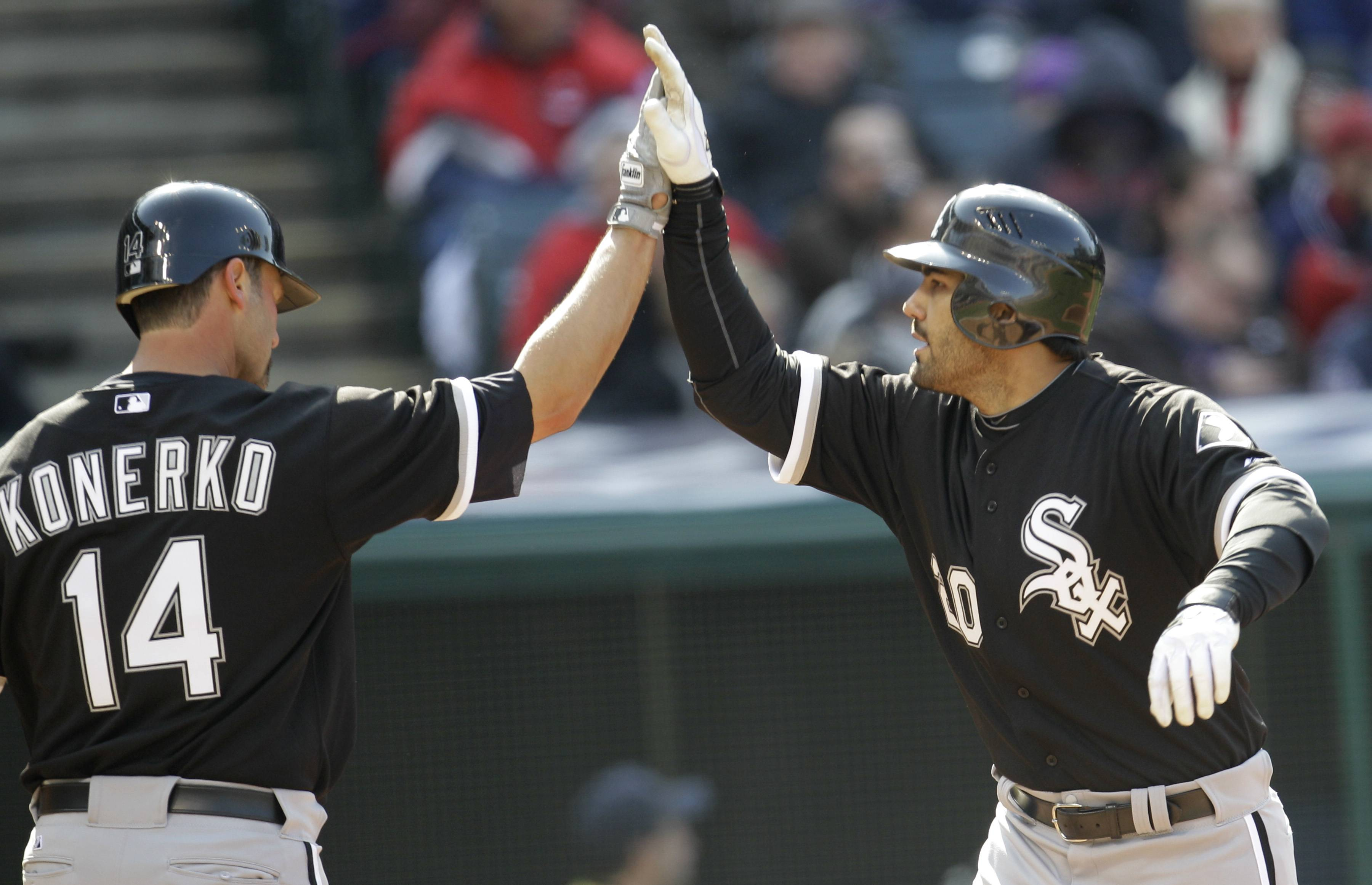 White Sox outfielder Carlos Quentin is congratulated by Paul Konerko after Quentin hit a two run home run in the third inning against the Cleveland Indians Friday.