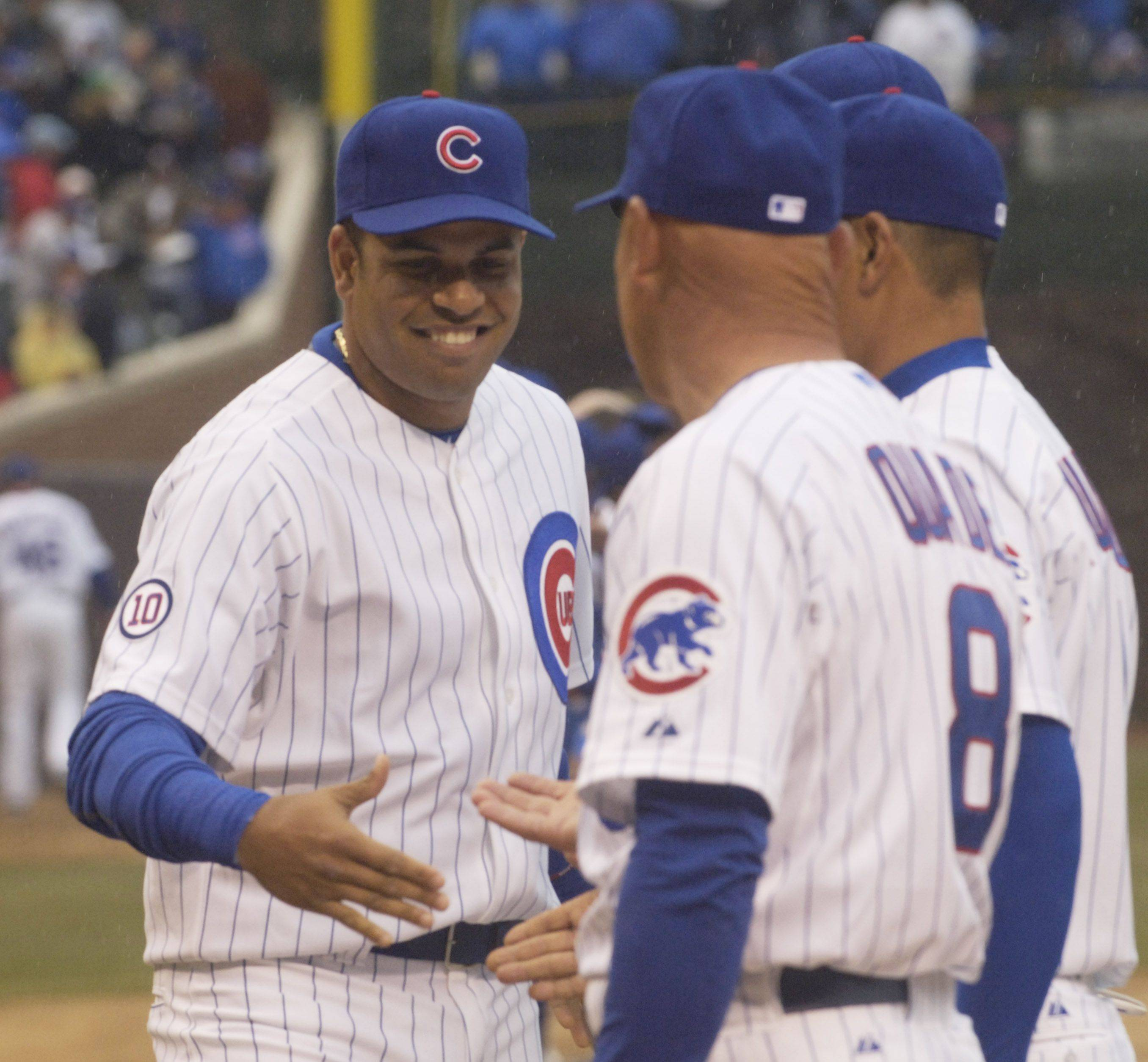 Cubs third baseman Aramis Ramirez is greeted by Manager Mike Quade.