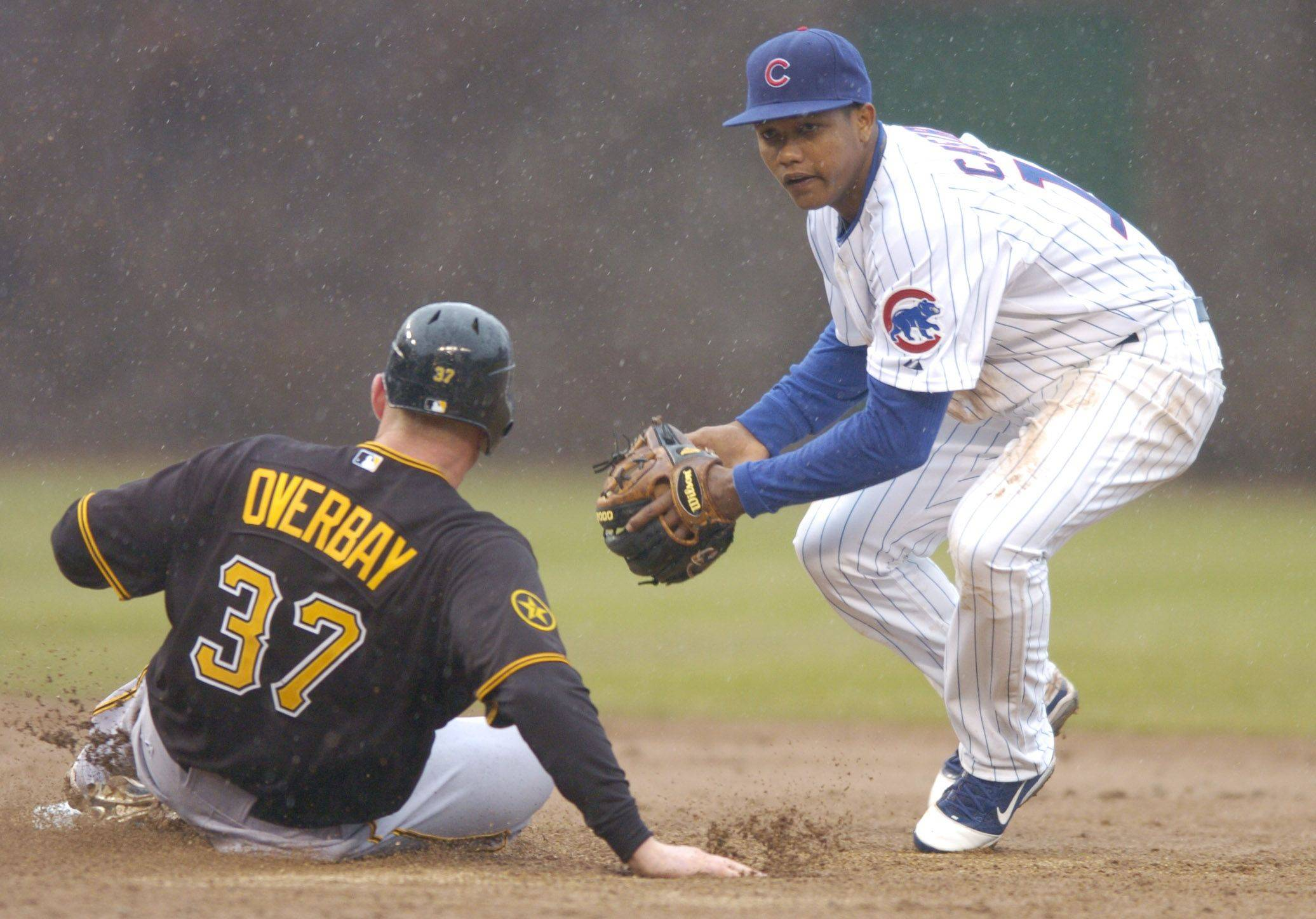 Starlin Castro of the Cubs is able to force Lyle Overbay of the Pirates but can't make the throw for a double play.