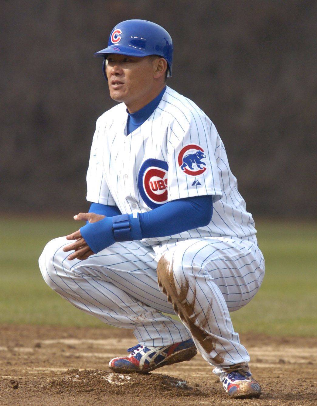 Kosuke Fukudome squats on second after advancing on a base hit .