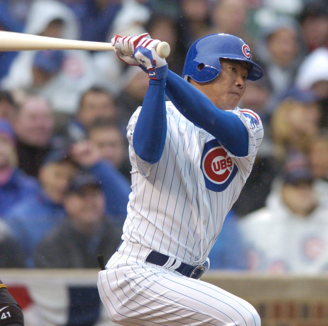 Kosuke Fukudome of the Cubs gets a base hit.