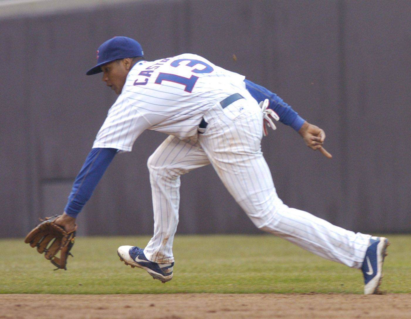 Cubs shortstop Starlin Castro positions himself to field a ground ball.
