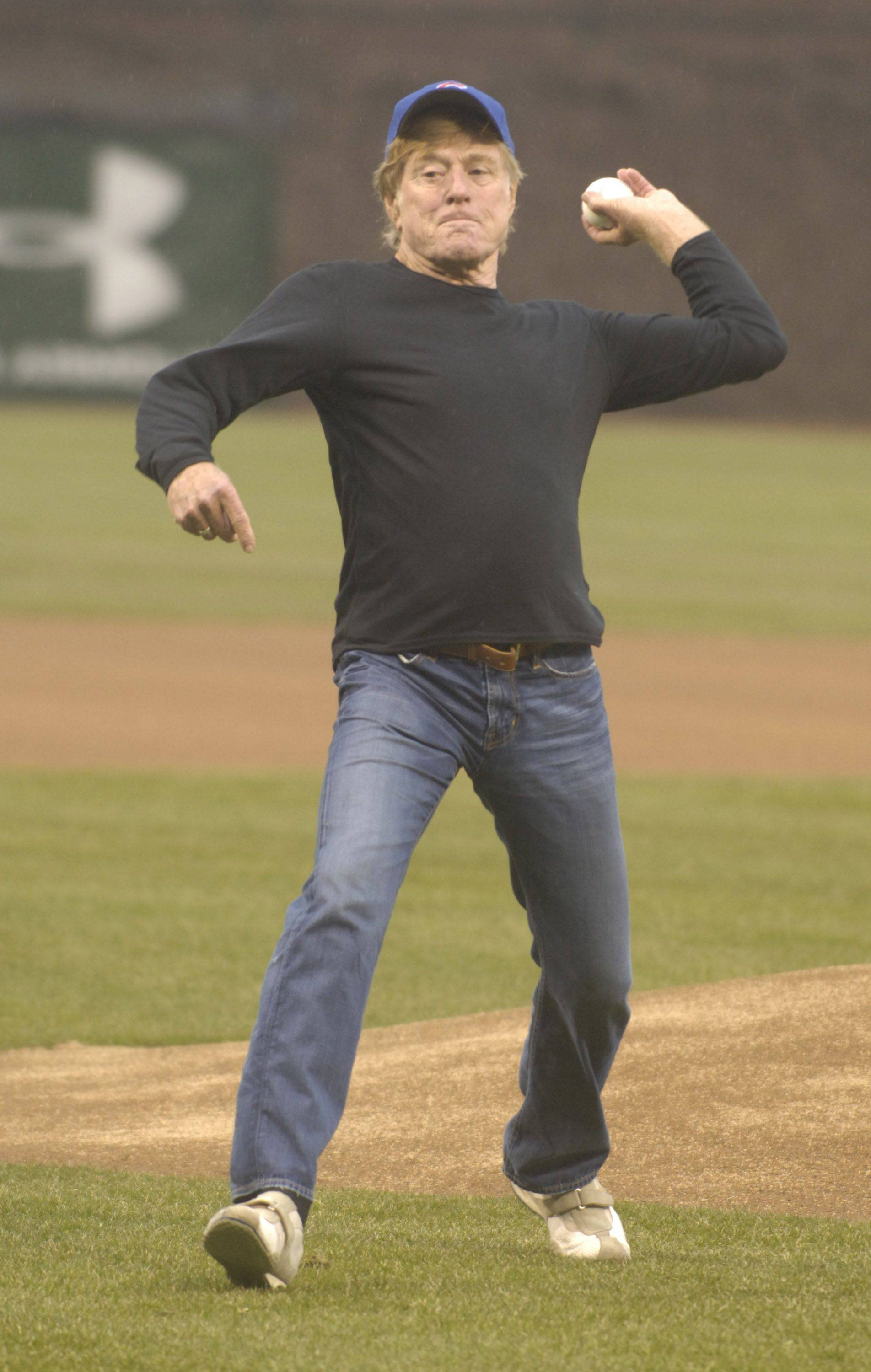 Actor and director Robert Redford throws out the first pitch.