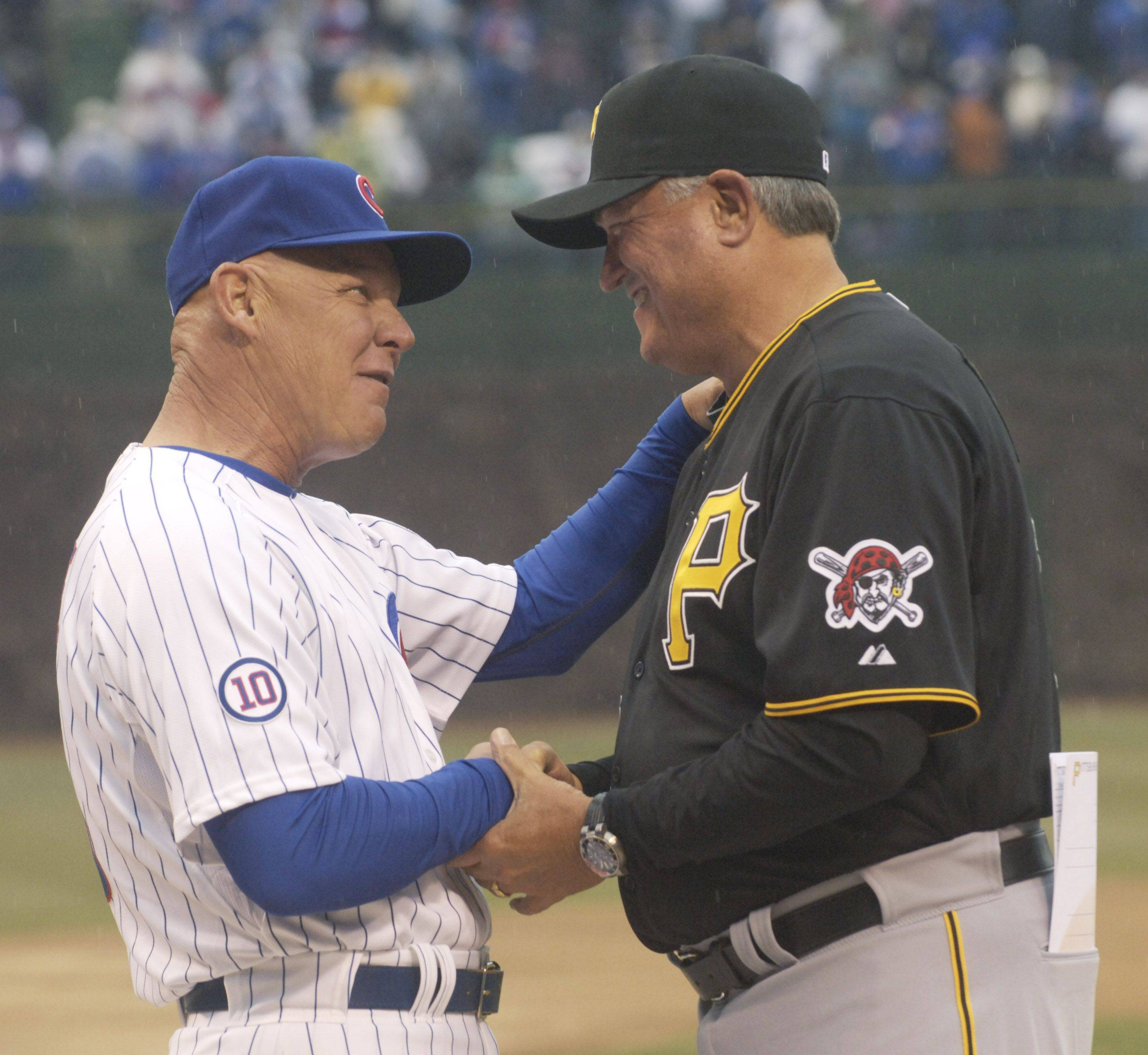 Cubs Manager Mike Quade, left, greets Pirates Manager Clint Hurdle.