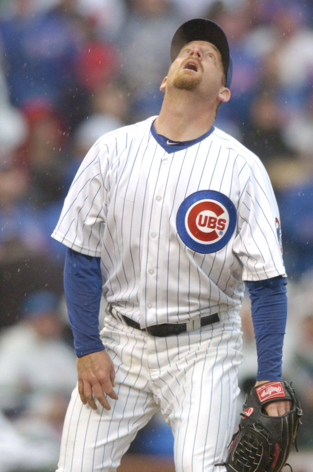 Cubs pitcher Ryan Dempster watches Neil Walker's grand slam sail out of the park during Friday's game on Opening Day at Wrigley Field.