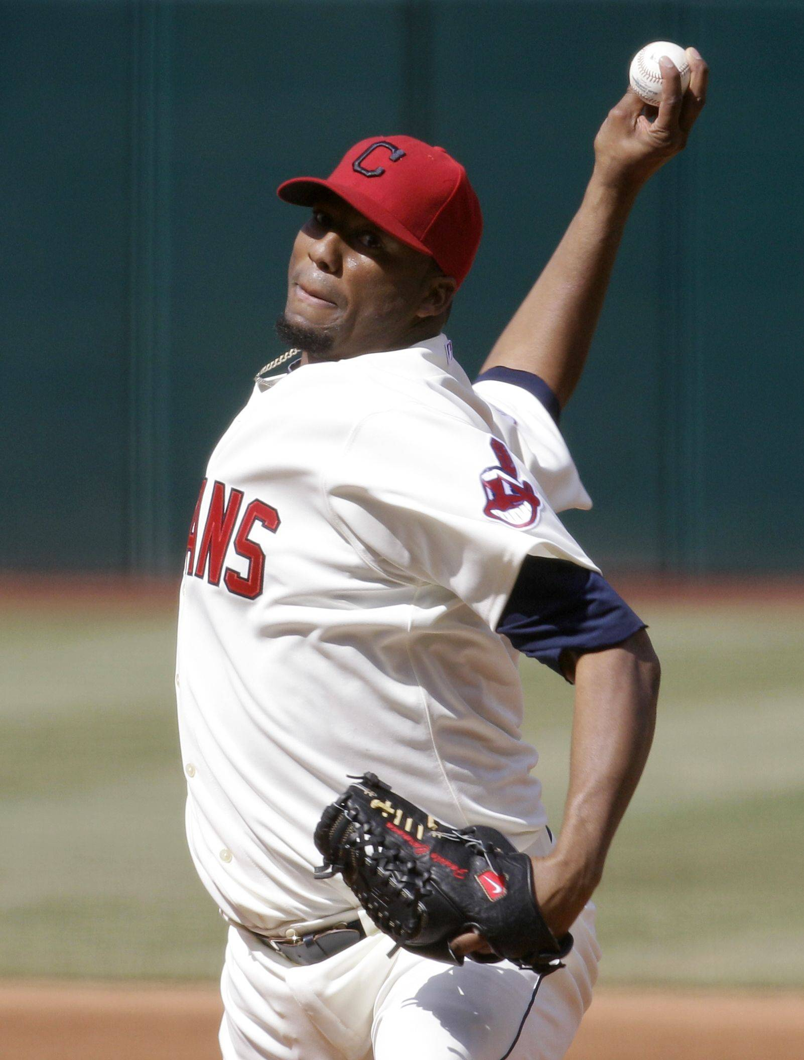 Cleveland Indians starting pitcher Fausto Carmona pitches to the Chicago White Sox in the first inning in an opening day baseball game, Friday, April 1, 2011, in Cleveland.