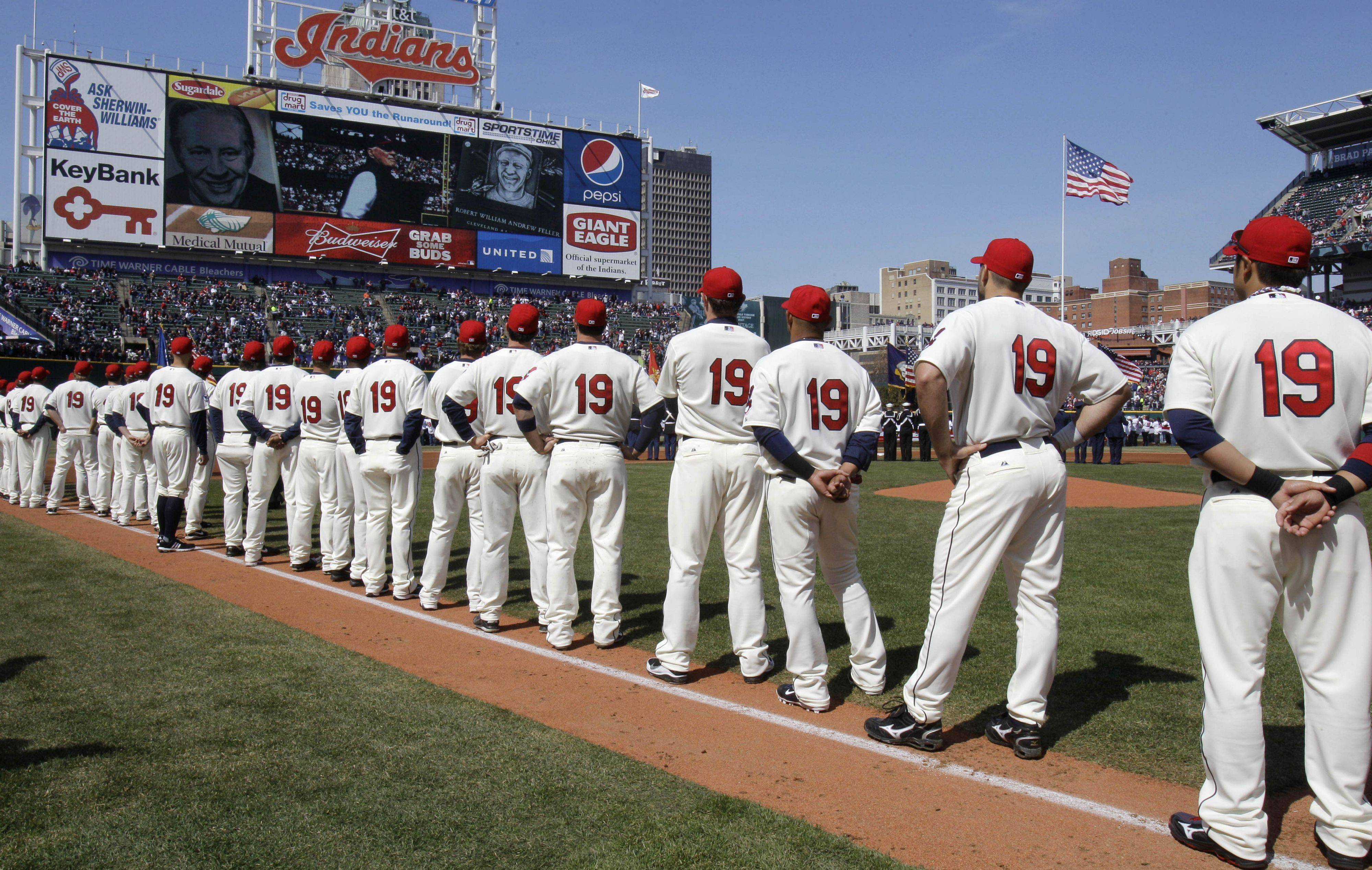 Members of the Cleveland Indians, all wearing No. 19, line up on the field during a special video tribute to the late Indians player Bob Feller before playing the Chicago White Sox in an opening day baseball game onFriday, April 1, 2011, in Cleveland.