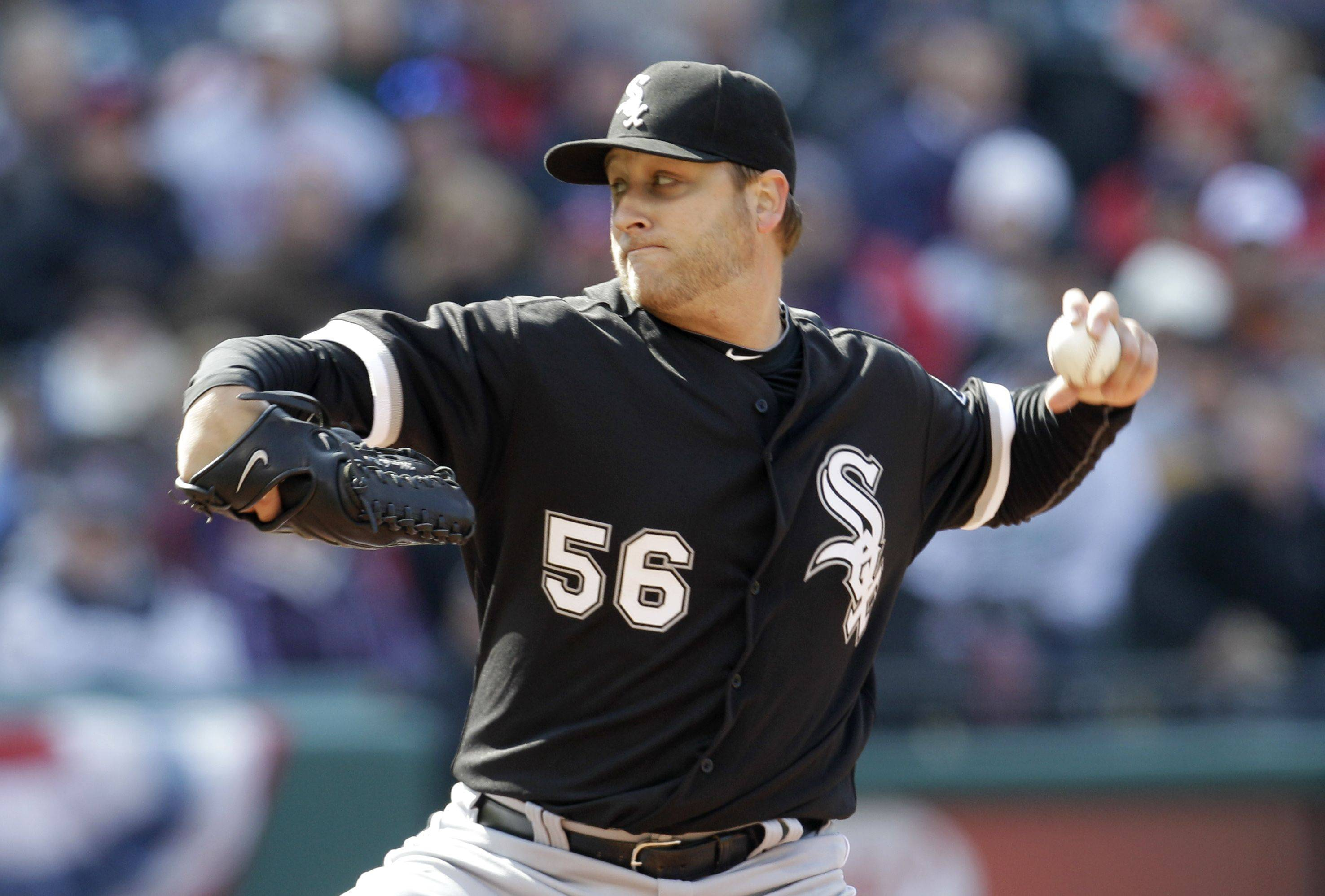 Chicago White Sox starting pitcher Mark Buehrle (56) throws during the second inning of an opening day baseball game against the Cleveland Indians, Friday, April 1, 2011, in Cleveland.