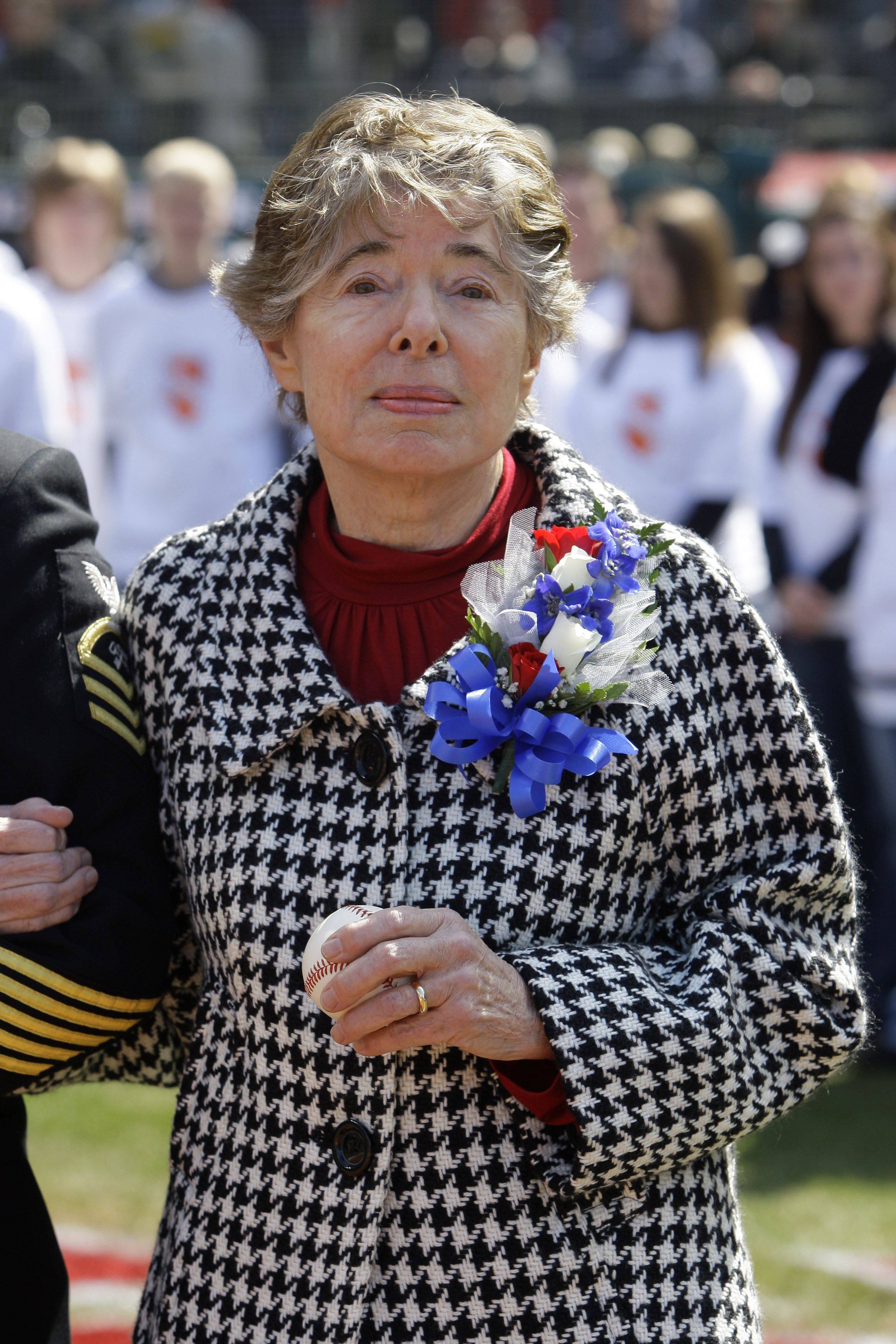 Anne Feller, wife of the late Cleveland Indians player Bob Feller, watches a video tribute of her husband before the Indians play the Chicago White Sox in an opening day baseball game on Friday, April 1, 2011, in Cleveland.
