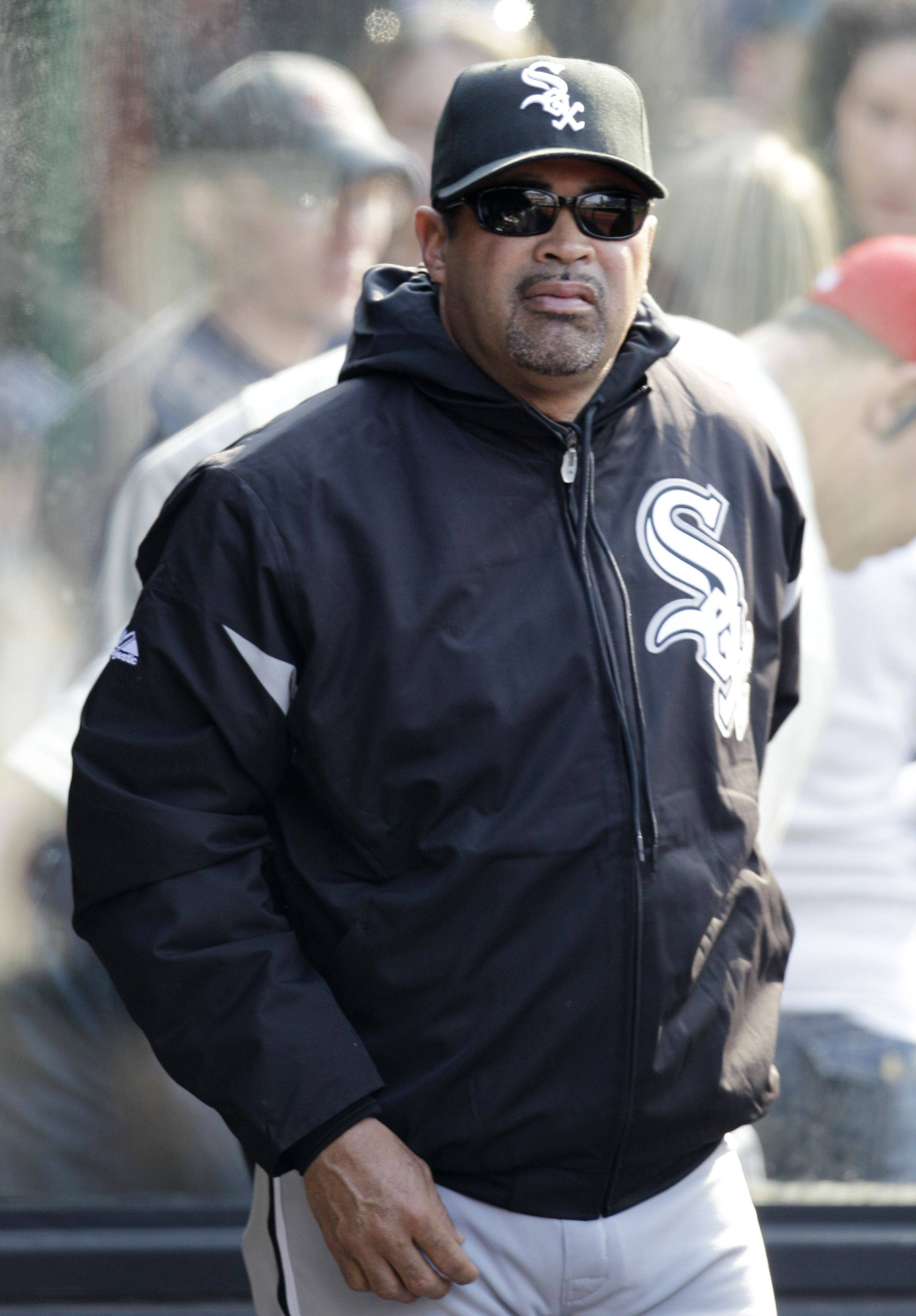 Chicago White Sox manager Ozzie Guillen watches from the dugout during the sixth inning in an opening day baseball game against the Cleveland Indians, Friday, April 1, 2011, in Cleveland.