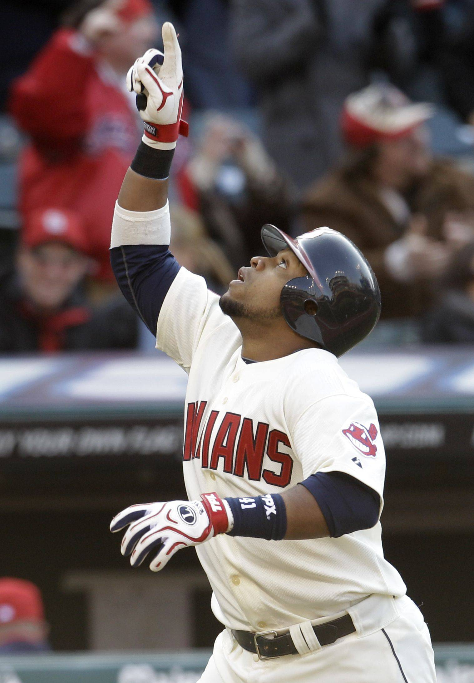 Cleveland Indians' Carlos Santana points up after hitting a two run home run off Chicago White Sox pitcher Will Ohman in the seventh inning in an opening day baseball game, Friday, April 1, 2011, in Cleveland. Asdrubal Cabrera scored.