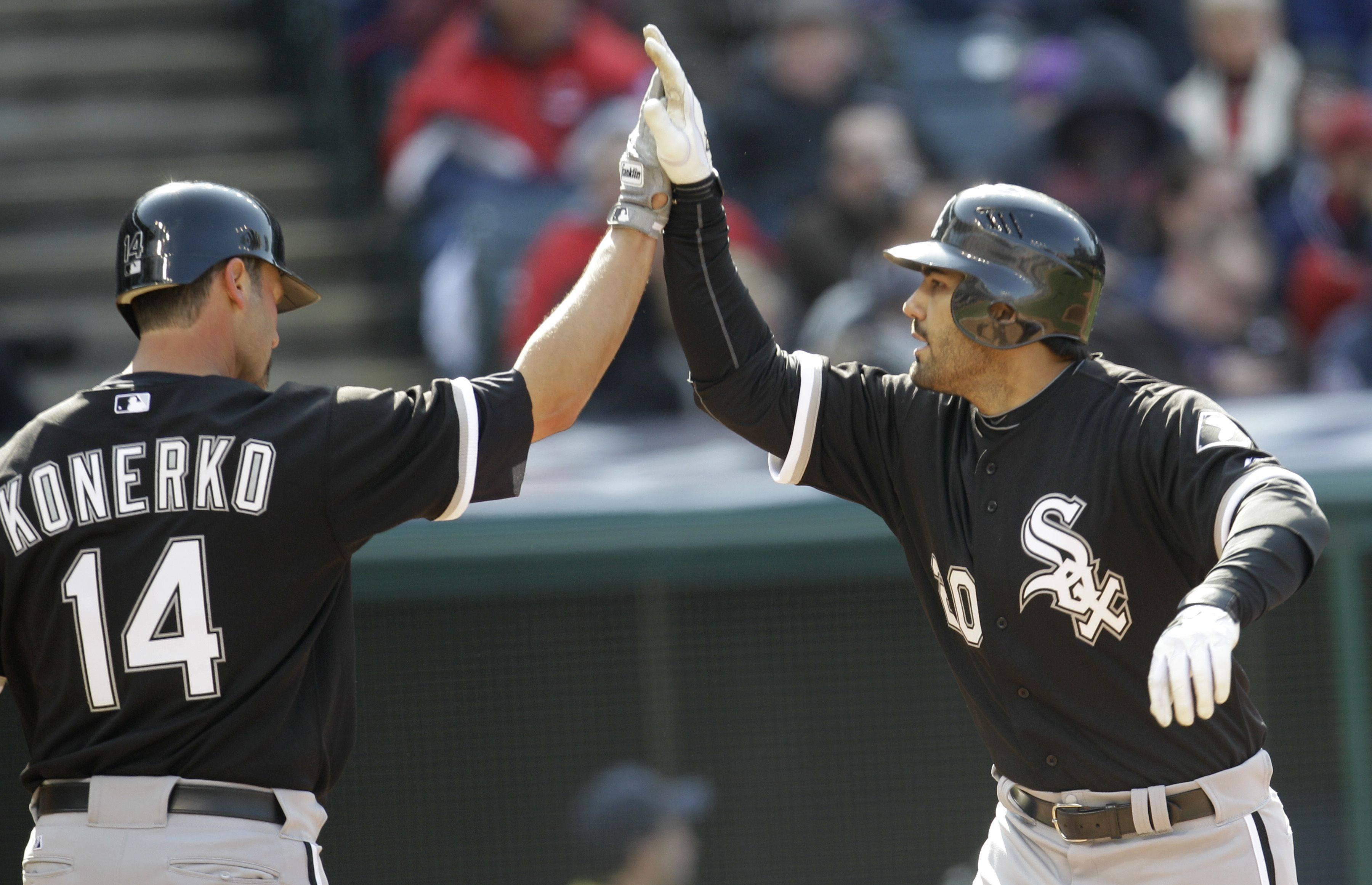 Chicago White Sox's Carlos Quentin, right, is congratulated by Paul Konerko after Quentin hit a two run home run in the third inning in an opening day baseball game against the Cleveland Indians, Friday, April 1, 2011, in Cleveland. Konerko scored.