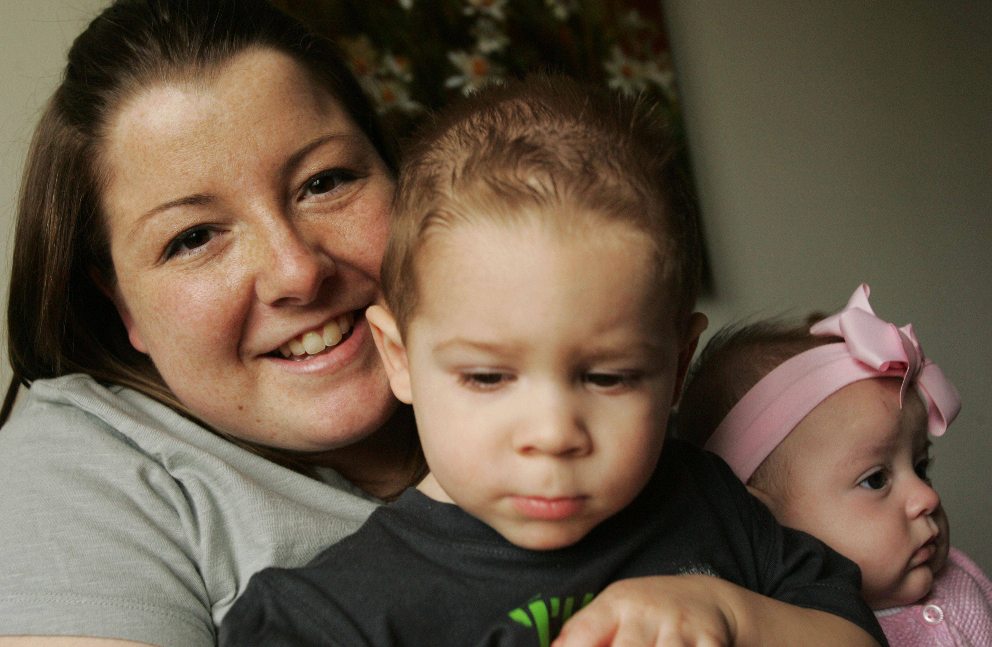 "Wendy Fink of Sycamore is a mother of ""two under 2"" -- Ayden, 21 months, and Leah, three-and-a-half months. She says she has been helped by a postpartum support group at TriCity Family Services in Geneva."
