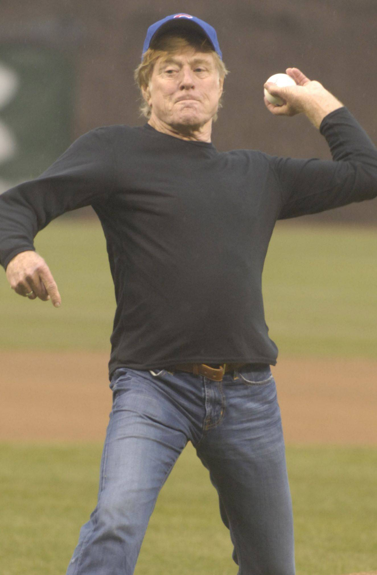 Actor and director Robert Redford throws out the ceremonial first pitch on Opening Day at Wrigley Field.