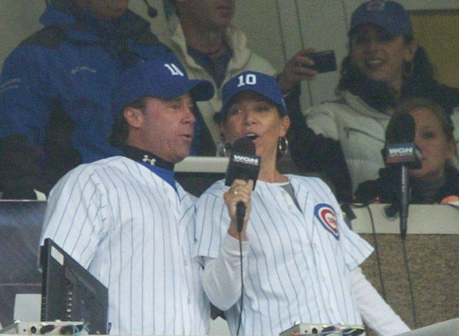 Ron Santo Jr. and Linda Santo Brown sing the seventh-inning stretch on Opening Day at Wrigley Field Friday.
