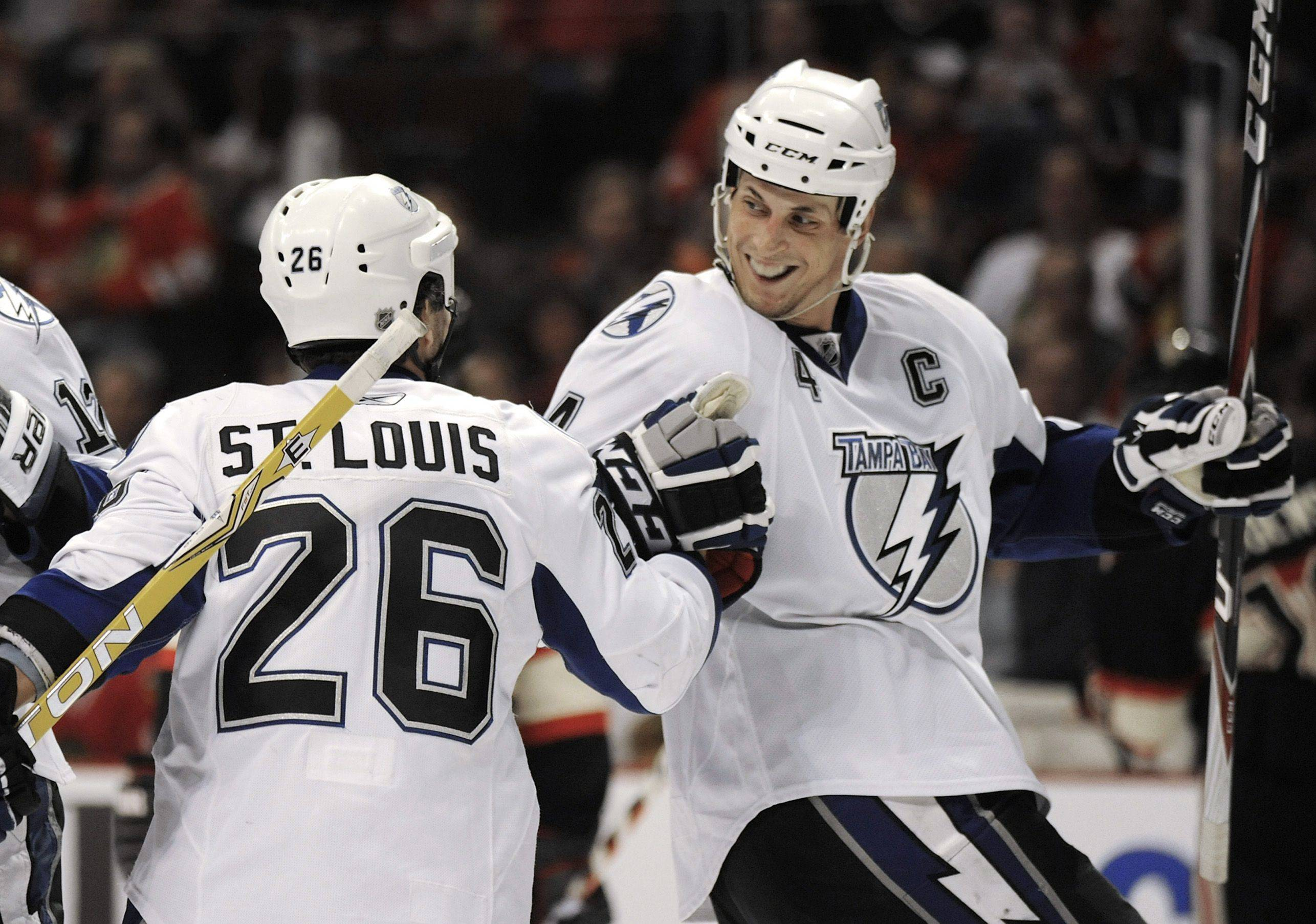 The Lightning's Vincent Lecavalier right, celebrates with teammate Martin St. Louis after scoring Sunday night against the Blackhawks in the first period at the United Center.