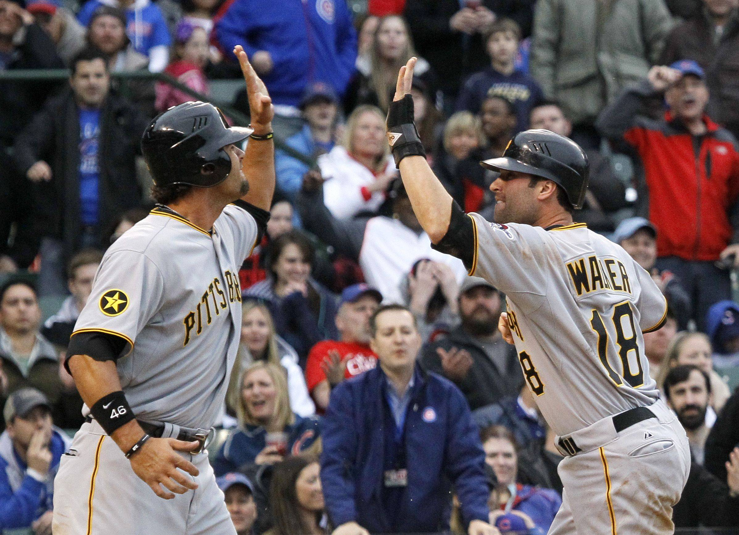 Pittsburgh Pirates' Garrett Jones, left, and Neil Walker celebrate after they both scored on a single by Pedro Alvarez during the ninth inning of a baseball game against the Chicago Cubs, Sunday, April 3, 2011 in Chicago. The Pirates won 5-4.