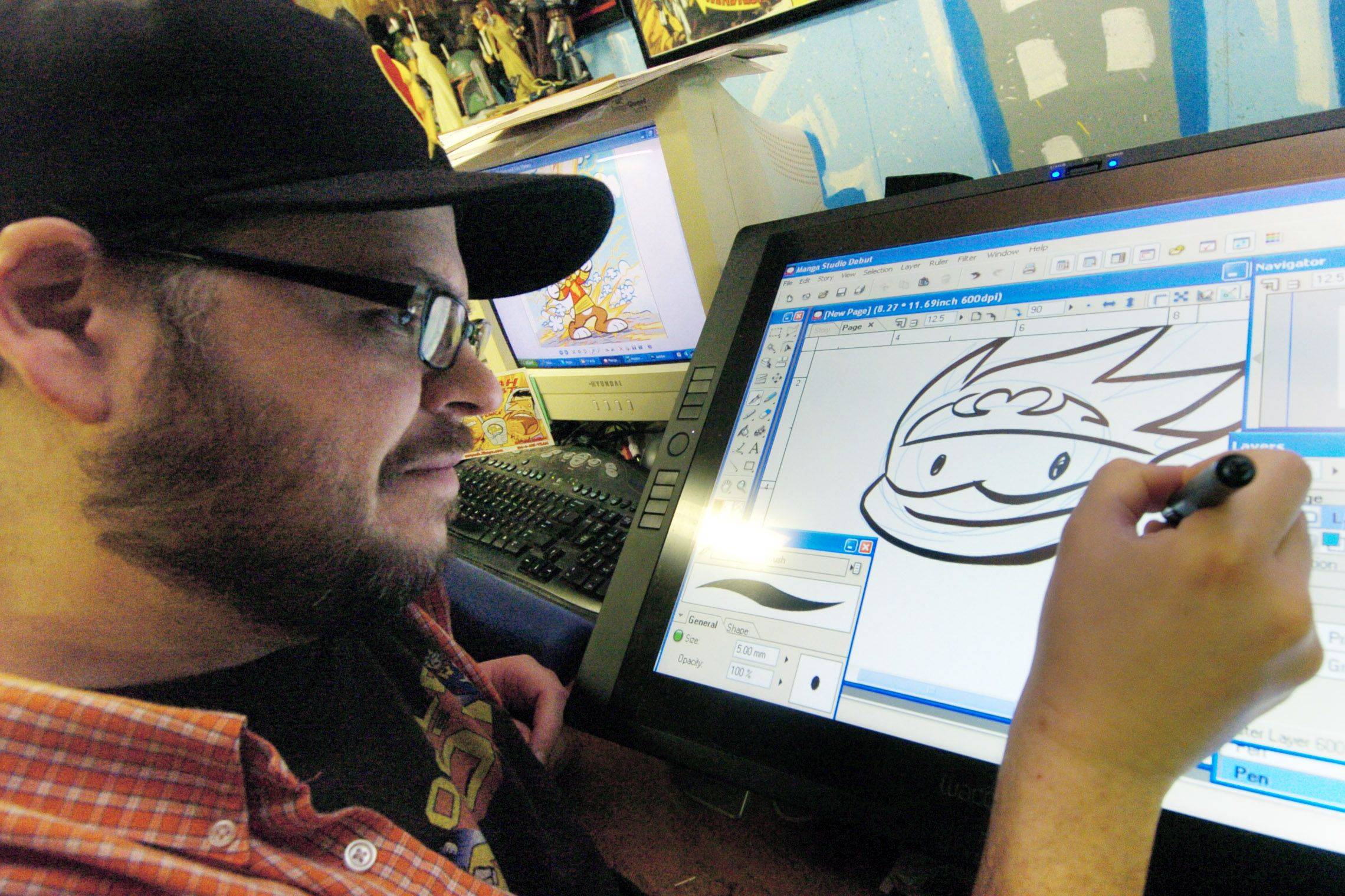"Comic book artist Art Baltazar of Streamwood draws his version of Batman's sidekick, Robin, on his computer for his popular DC Comics title ""Tiny Titans."""