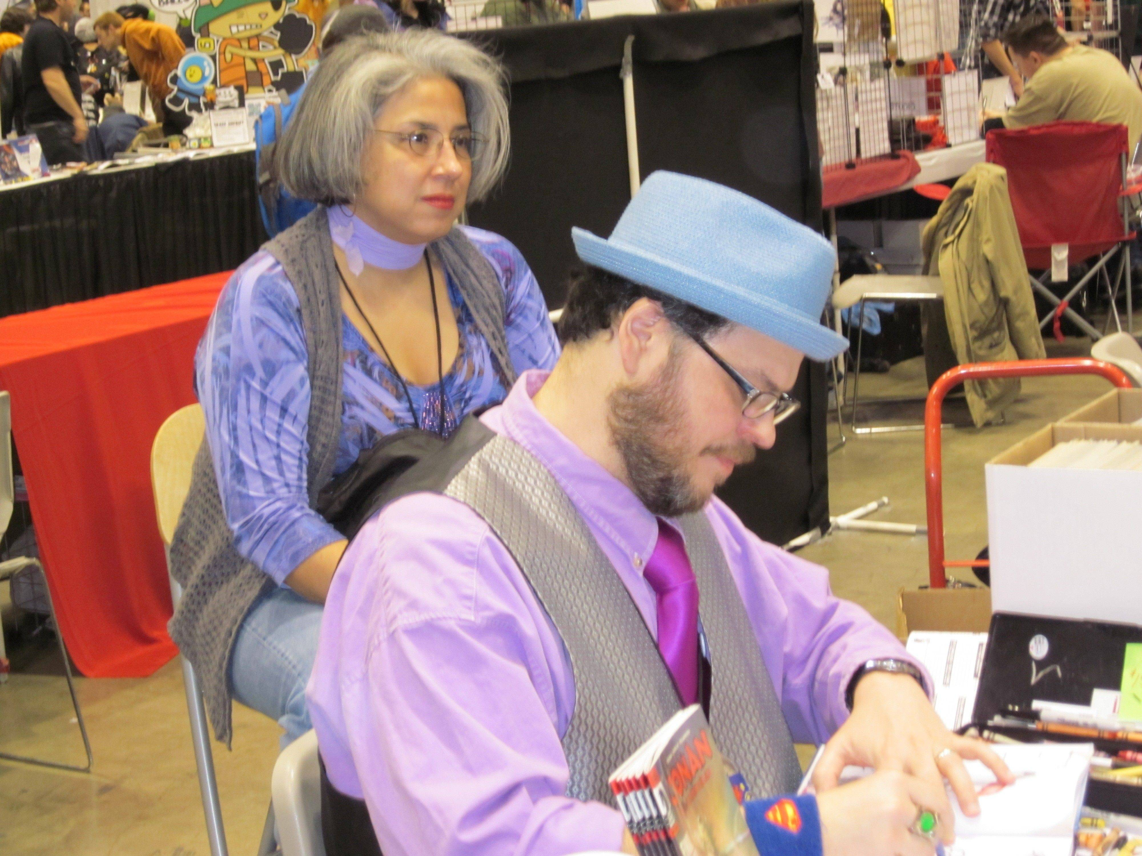 Streamwood's Art Baltazar draws sketches for fans as his wife, Rose, watches at Chicago's C2E2 convention.